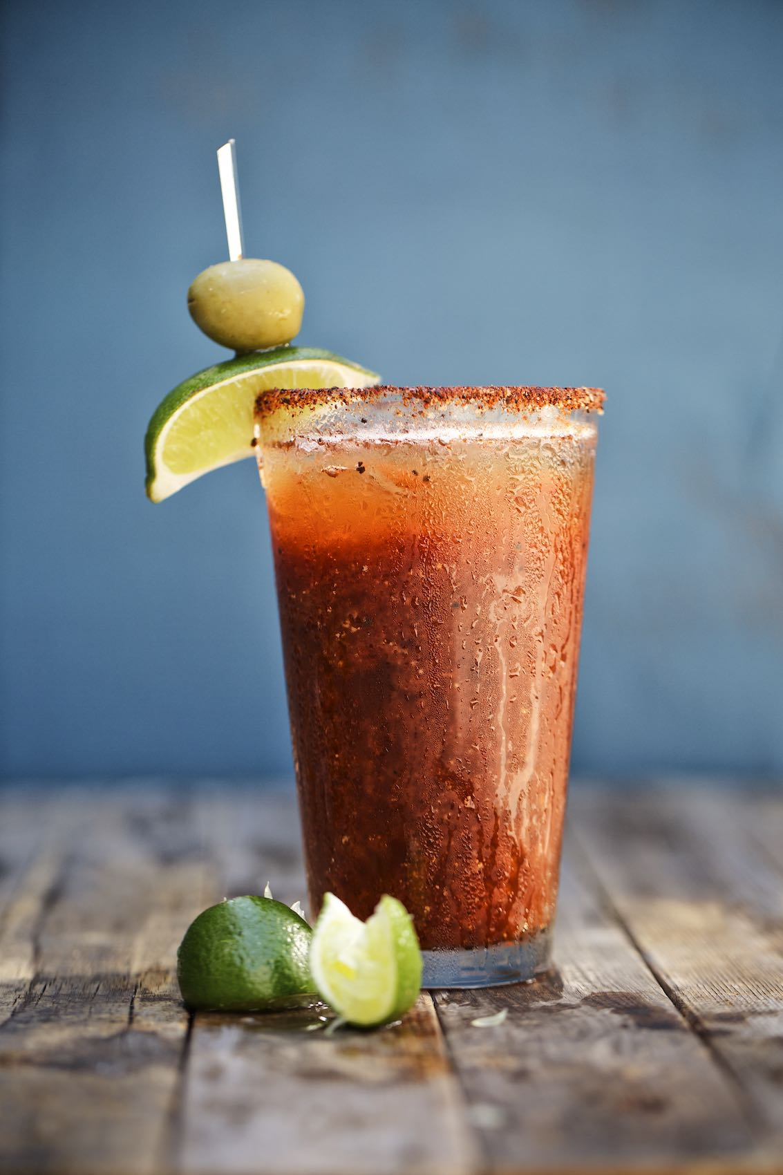 Jody Horton Photography - Michelada with lime on wood board at Smoke for Rizzoli Books.
