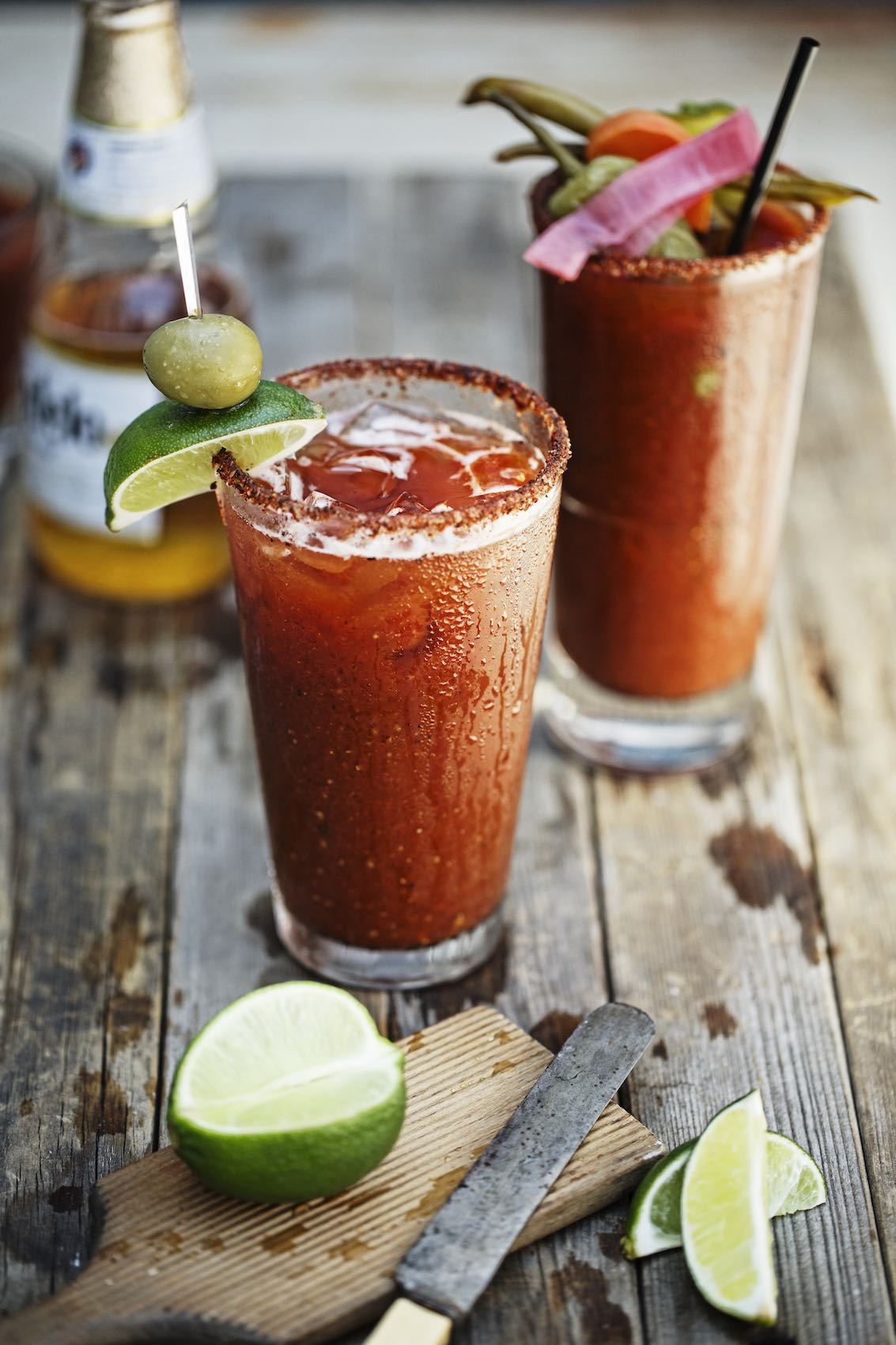 Jody Horton Photography - Bloody Mary, michelada and Modelo Especial on wood table at Smoke for Rizzoli Books.