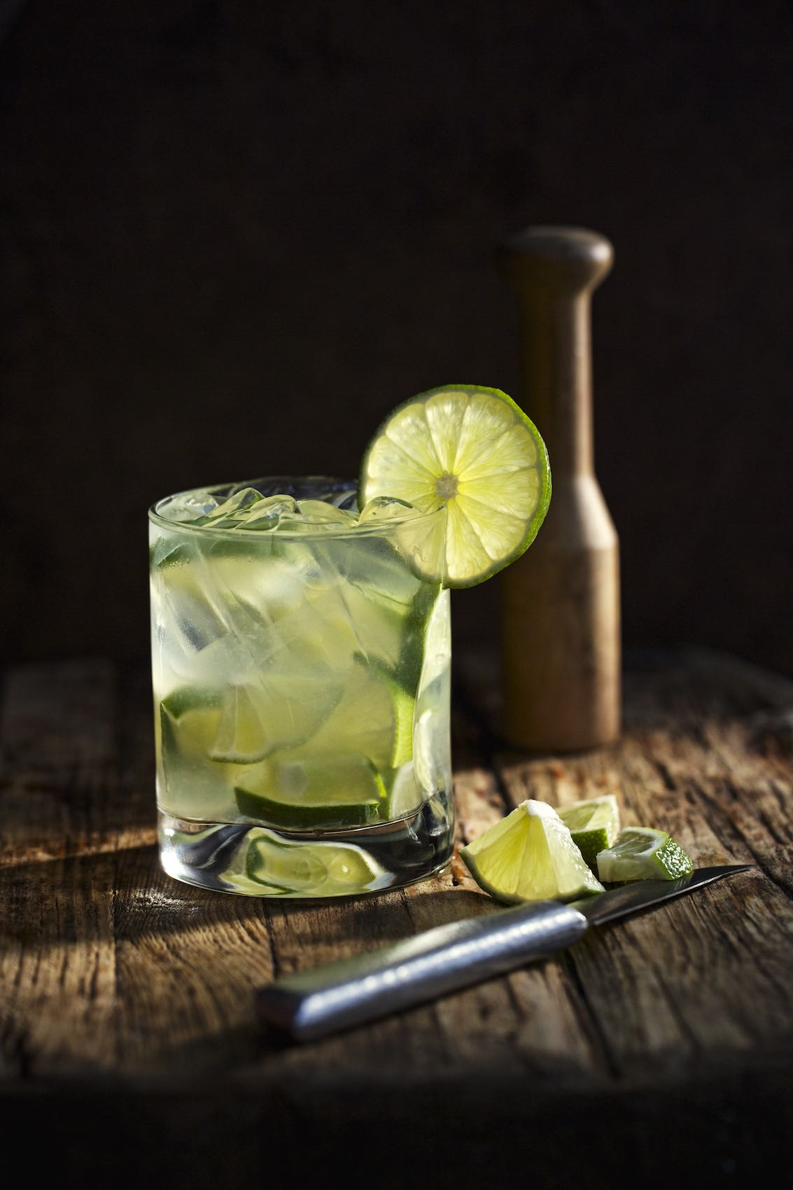 Jody Horton Photography - Caipirinha for Fogo de Chao on cutting board with knife and muddler.