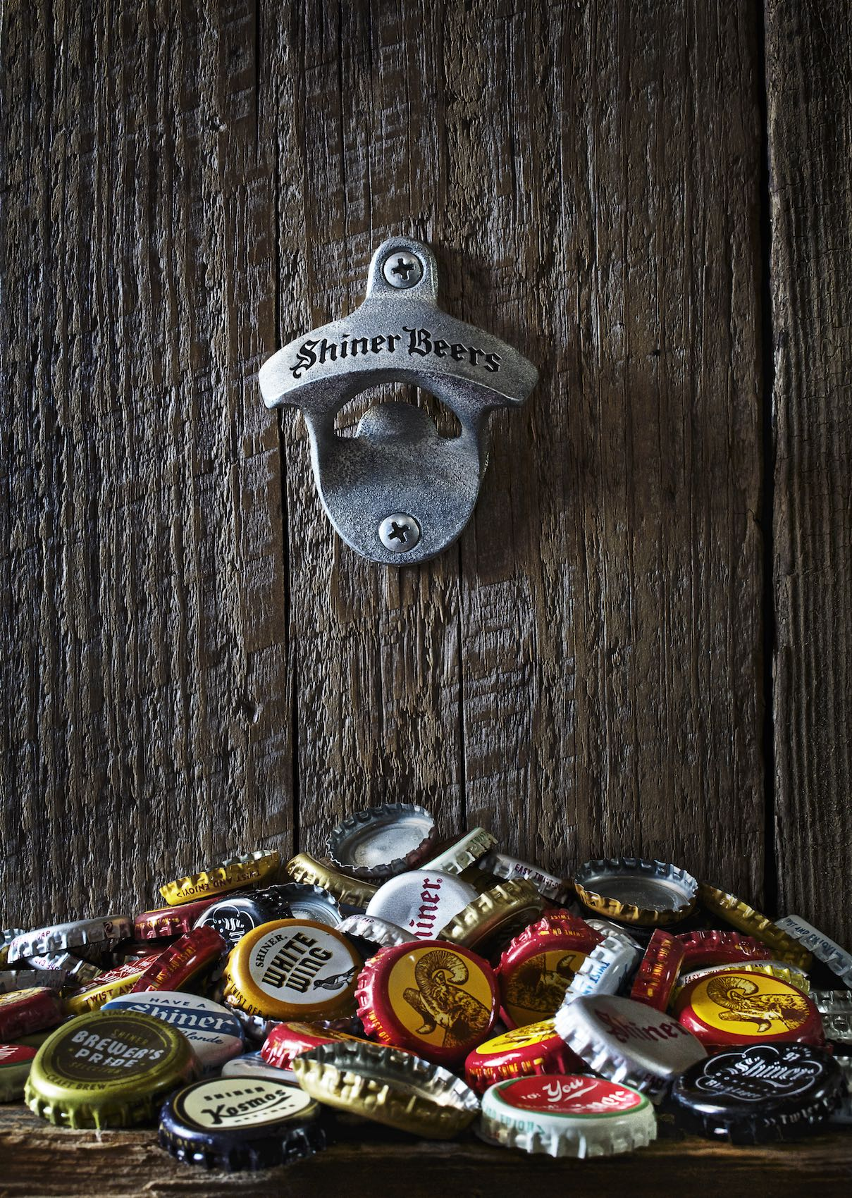 Jody Horton Photography - Shiner Beer Billboard with wood backdrop, bottle opener and variety of Shiner bottle caps.