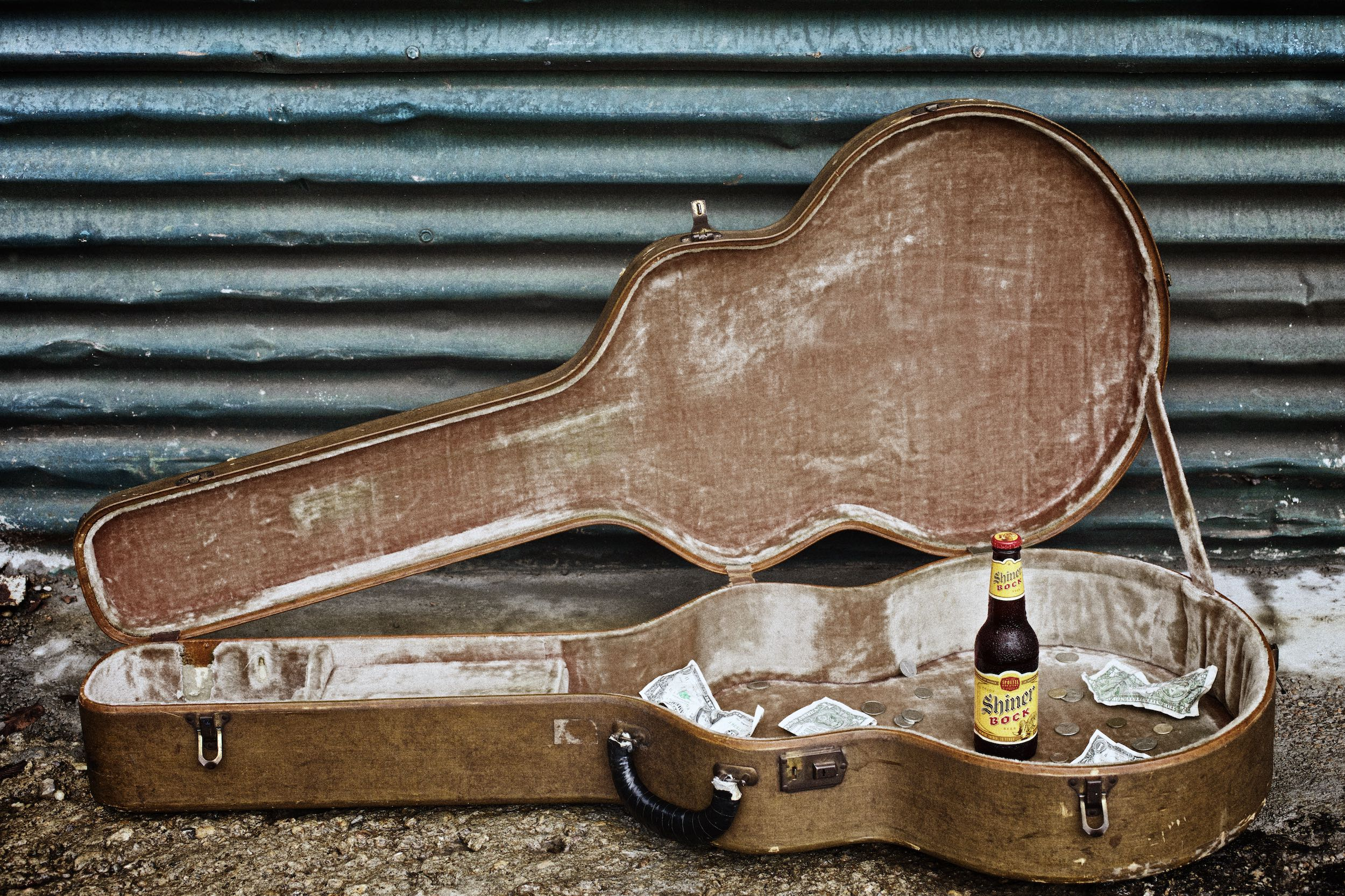 Jody Horton Photography - Shiner Bock Billboard for Austin City Limits with open guitar case and cold bottle of Shiner left as a tip.