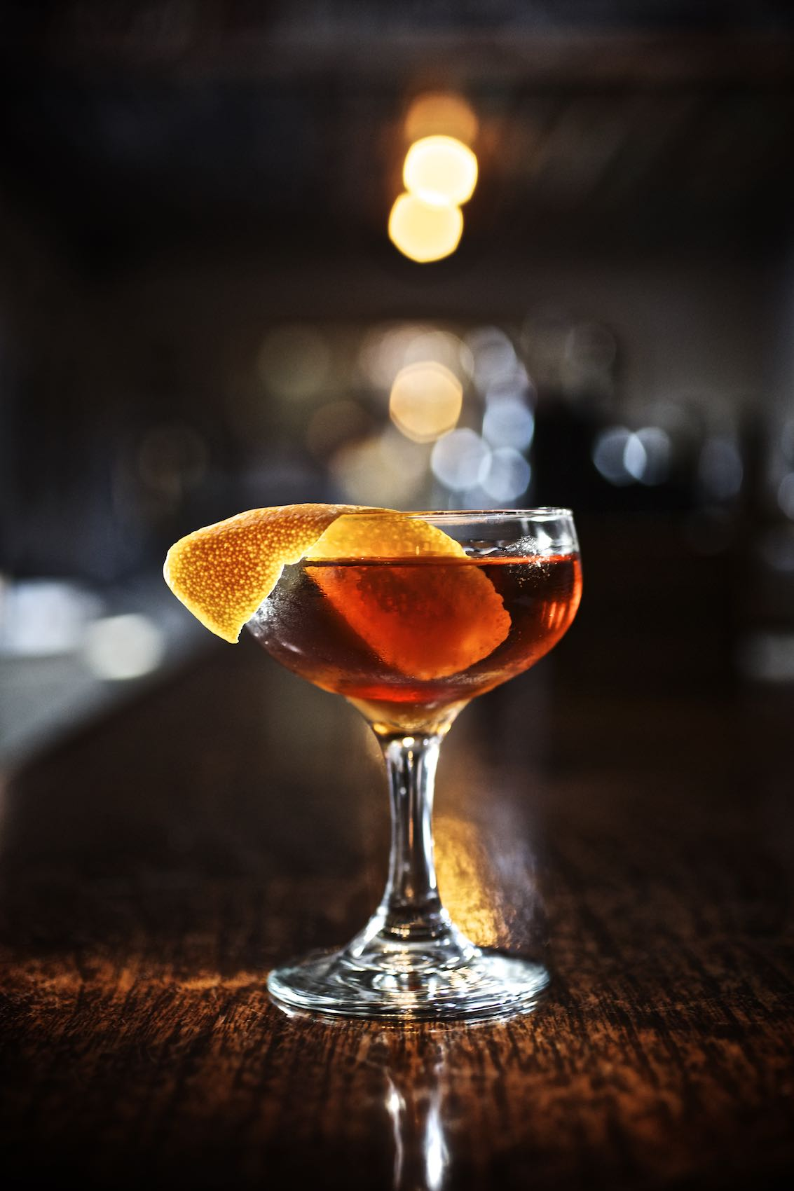 Jody Horton Photography - Red cocktail in coupe glass with orange garnish at Whisler