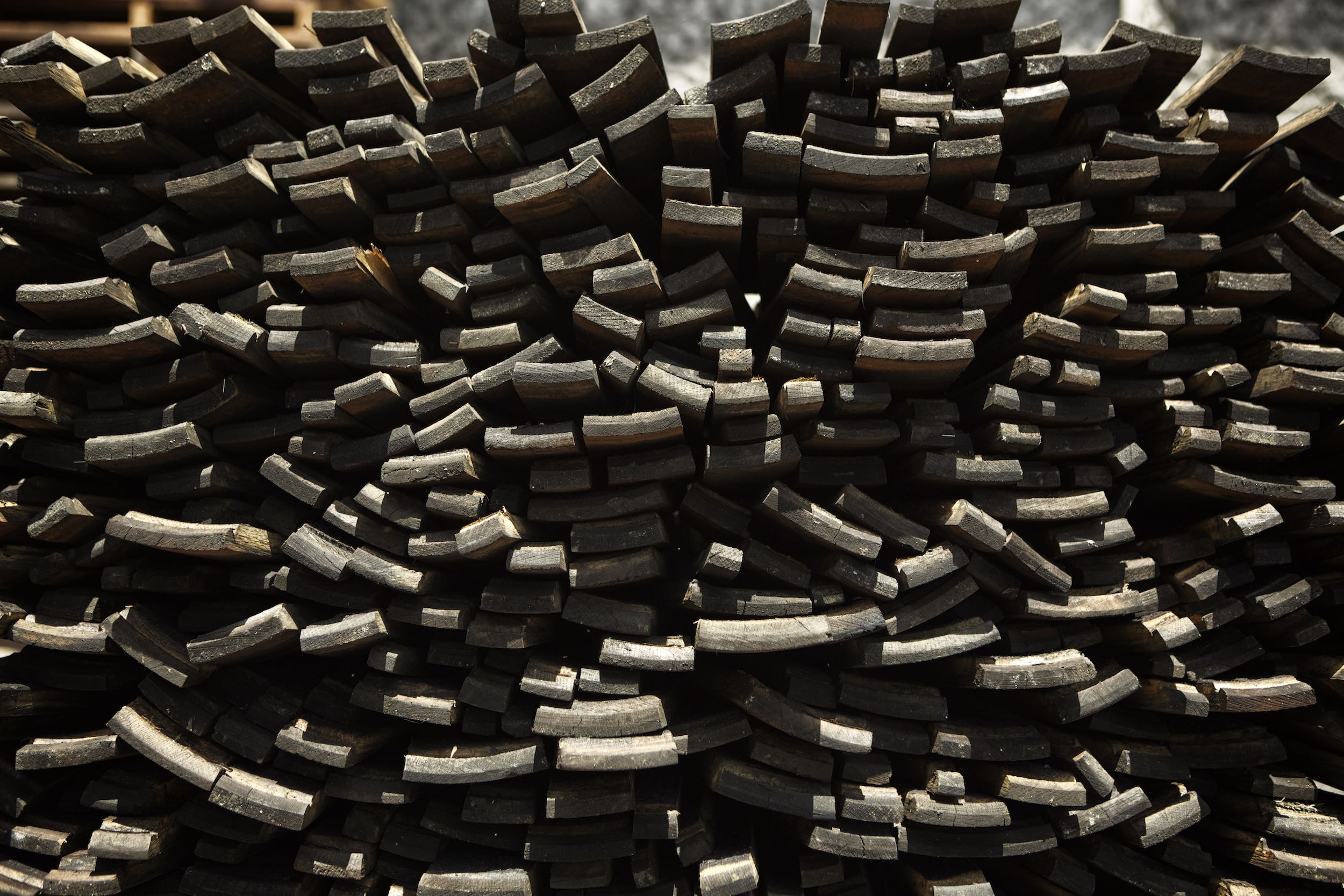 Jody Horton Photography - Stack of burned barrel staves for Rhum in Martinique.