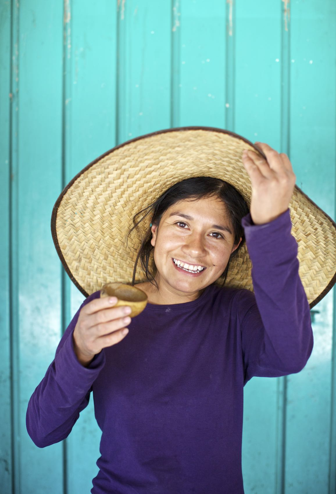Jody Horton Photography - Young woman in straw hat and purple shirt tasting mezcal.