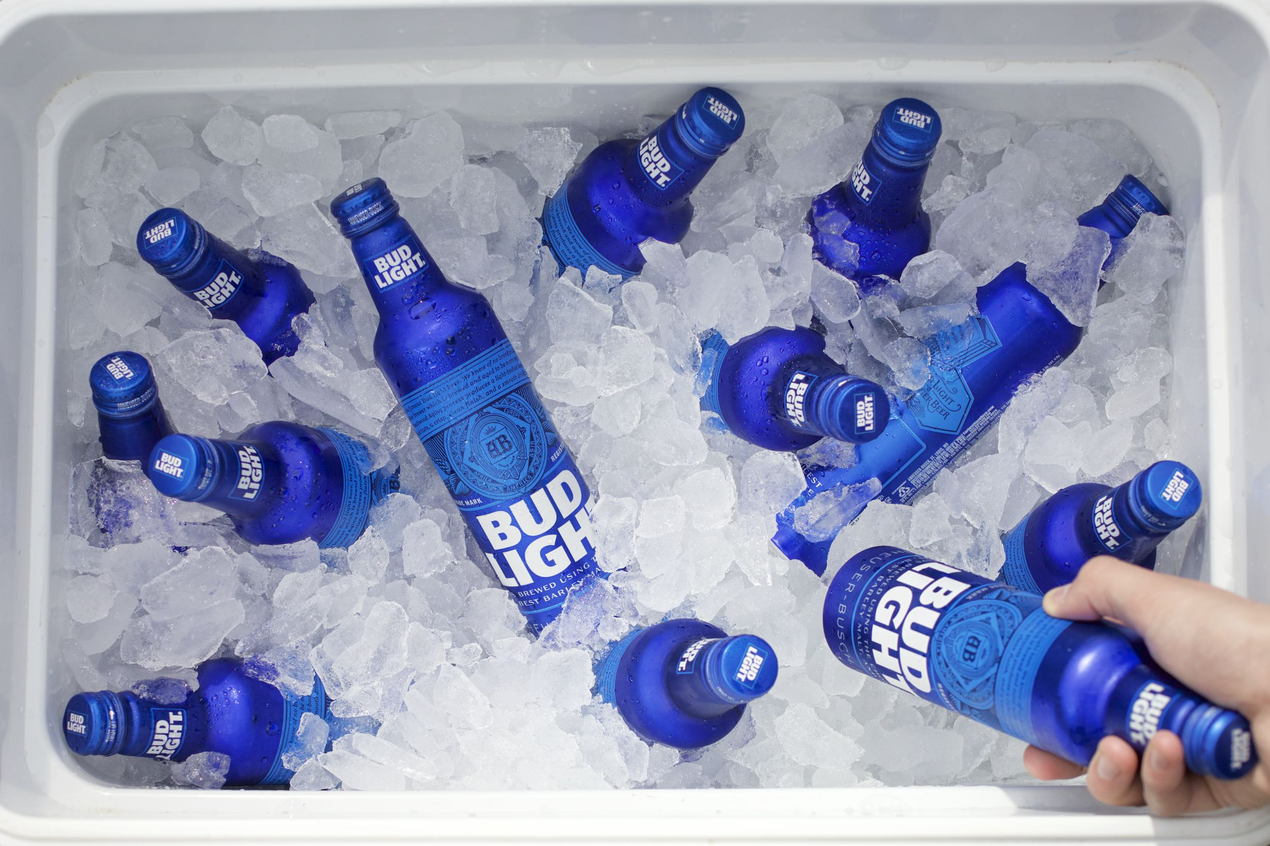 Jody Horton Photography - Cooler of Bud Light aluminum bottles.