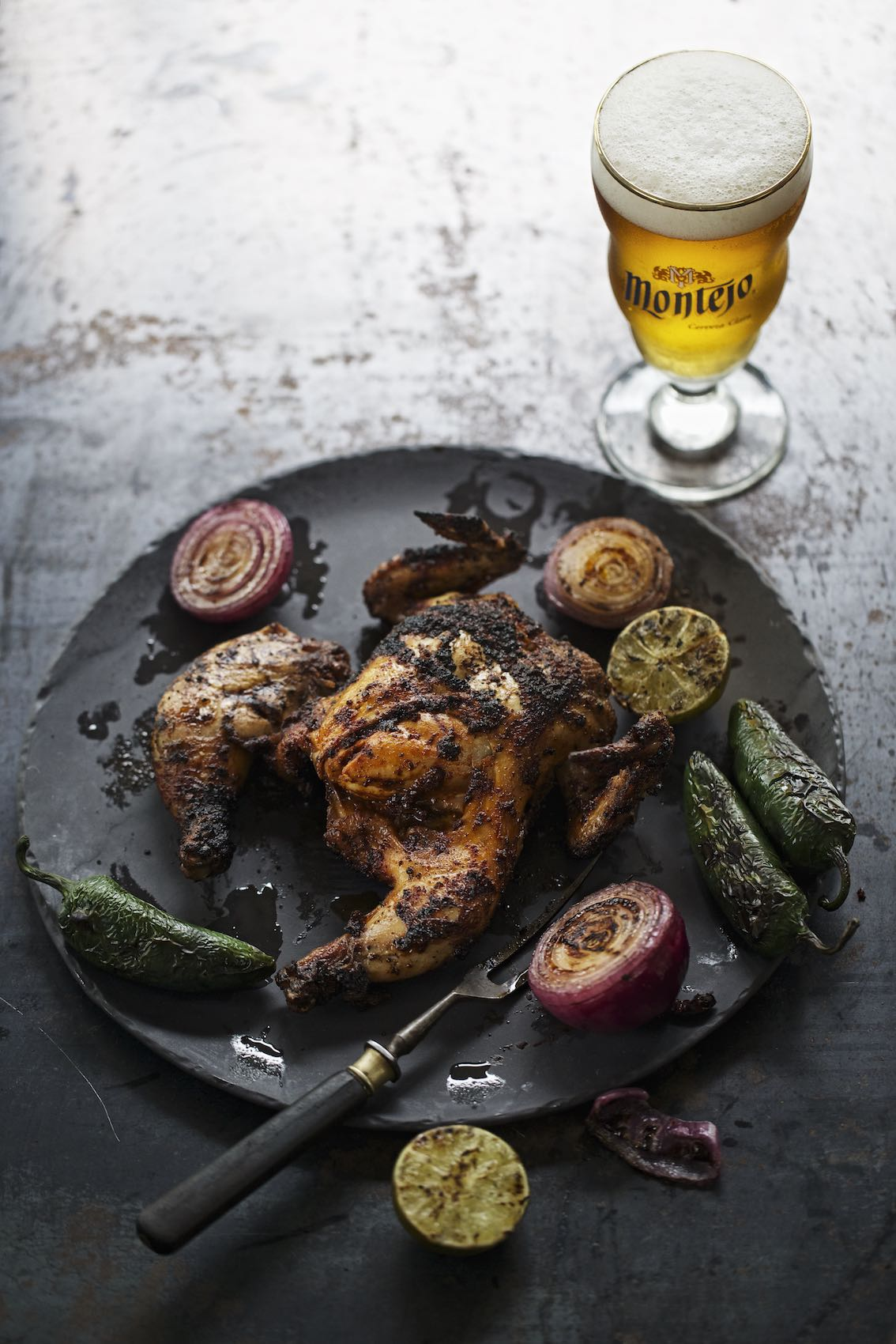 Jody Horton Photography - Montejo Beer with grilled chicken and vegetables on slate plate.