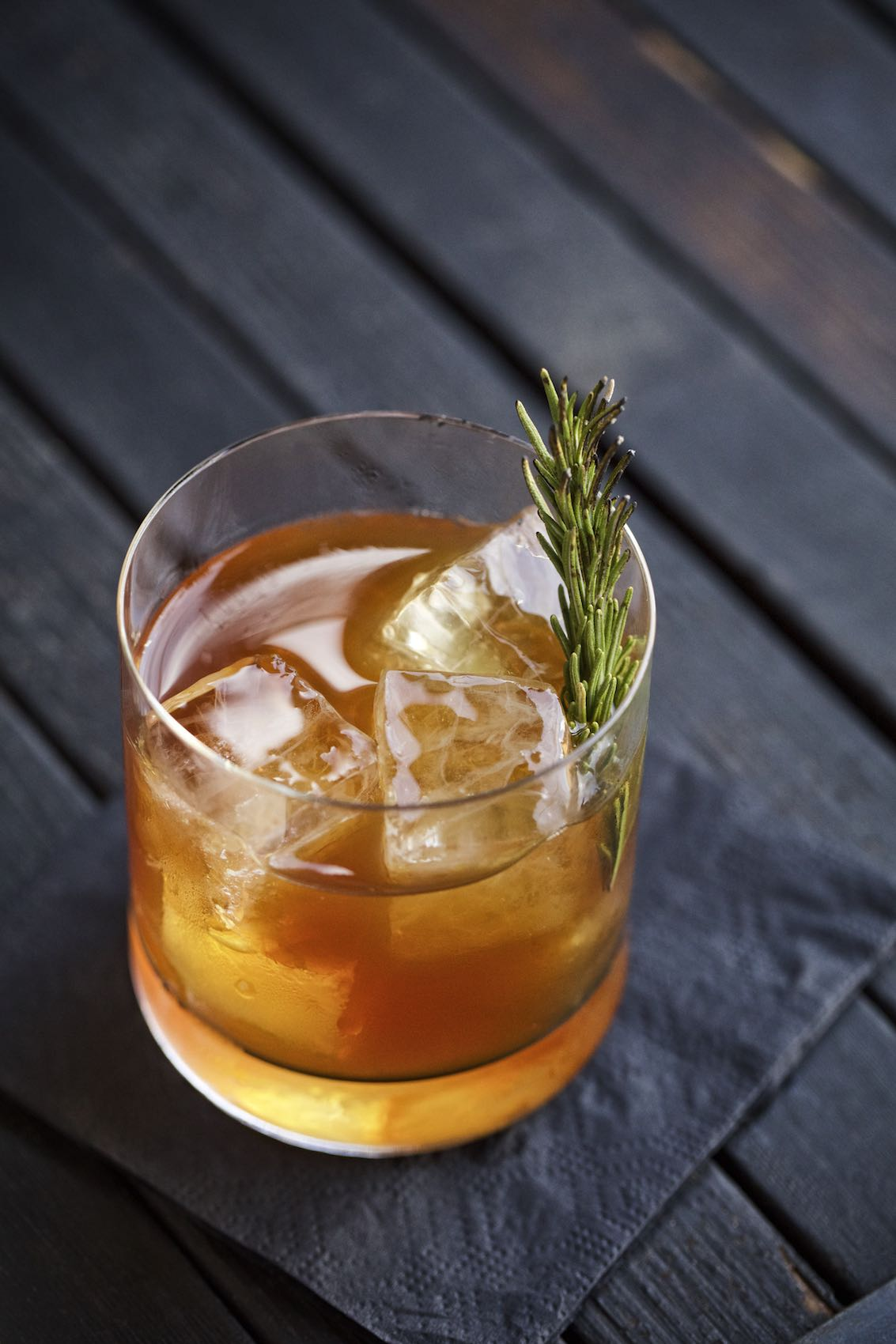 Jody Horton Photography - Iced whiskey cocktail with rosemary sprig at Kemuri, Austin, TX.