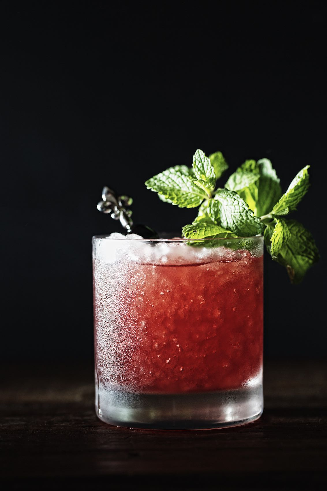 Jody Horton Photography - Iced red cocktail with mint garnish.