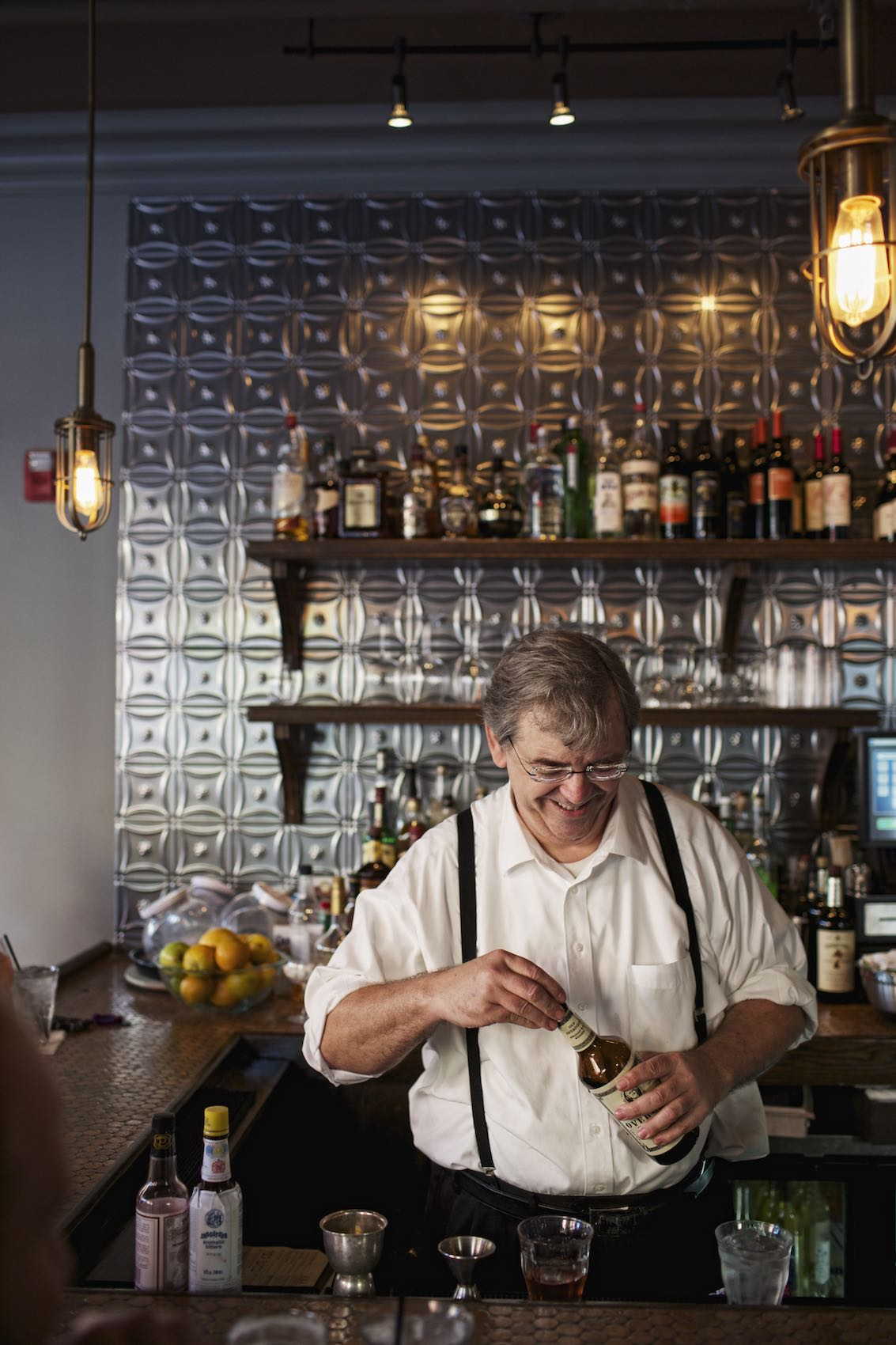 Jody Horton Photography - Bartender behind bar at Kingfish, New Orleans.