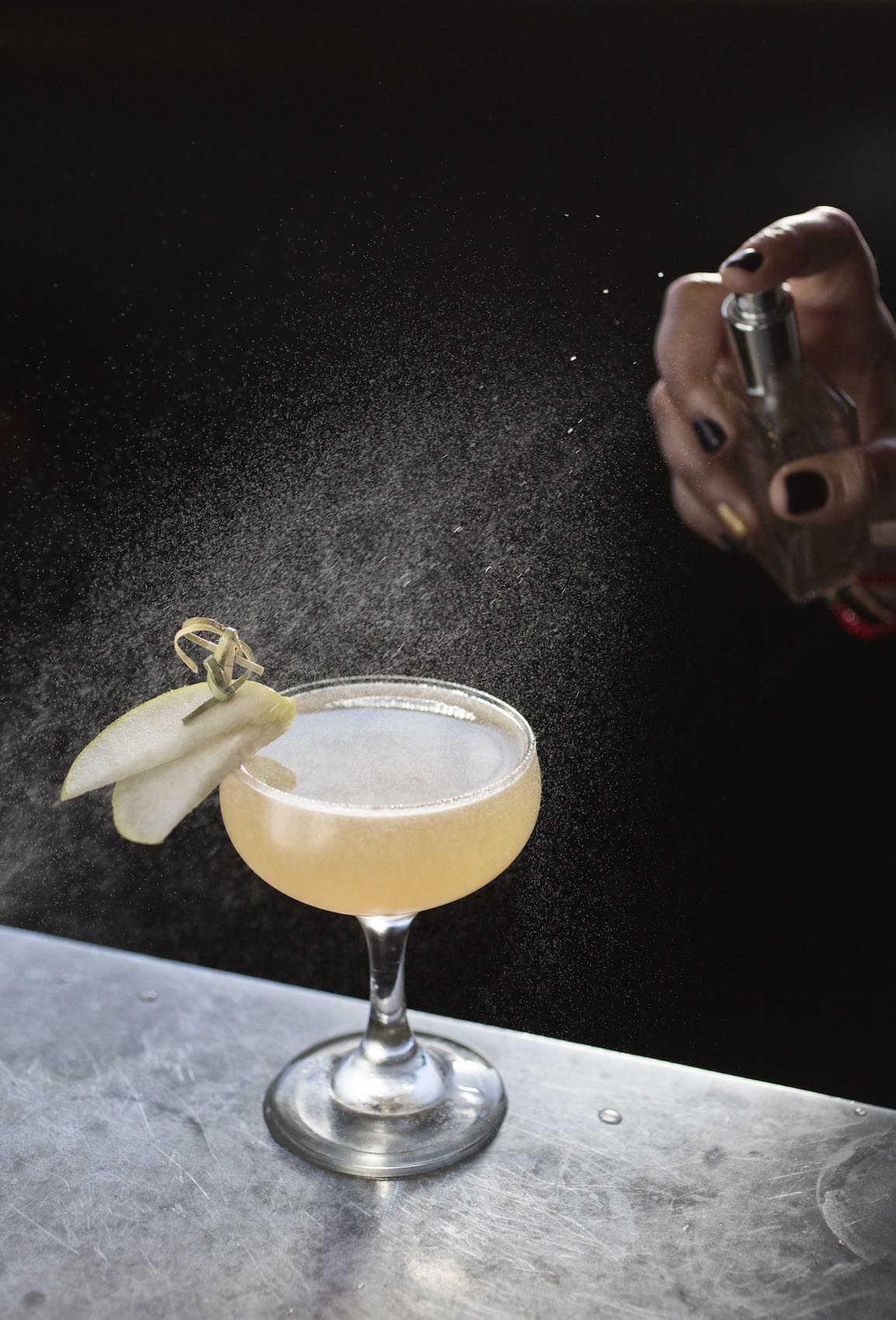 Jody Horton Photography - Misted cocktail in coup glass on granite.