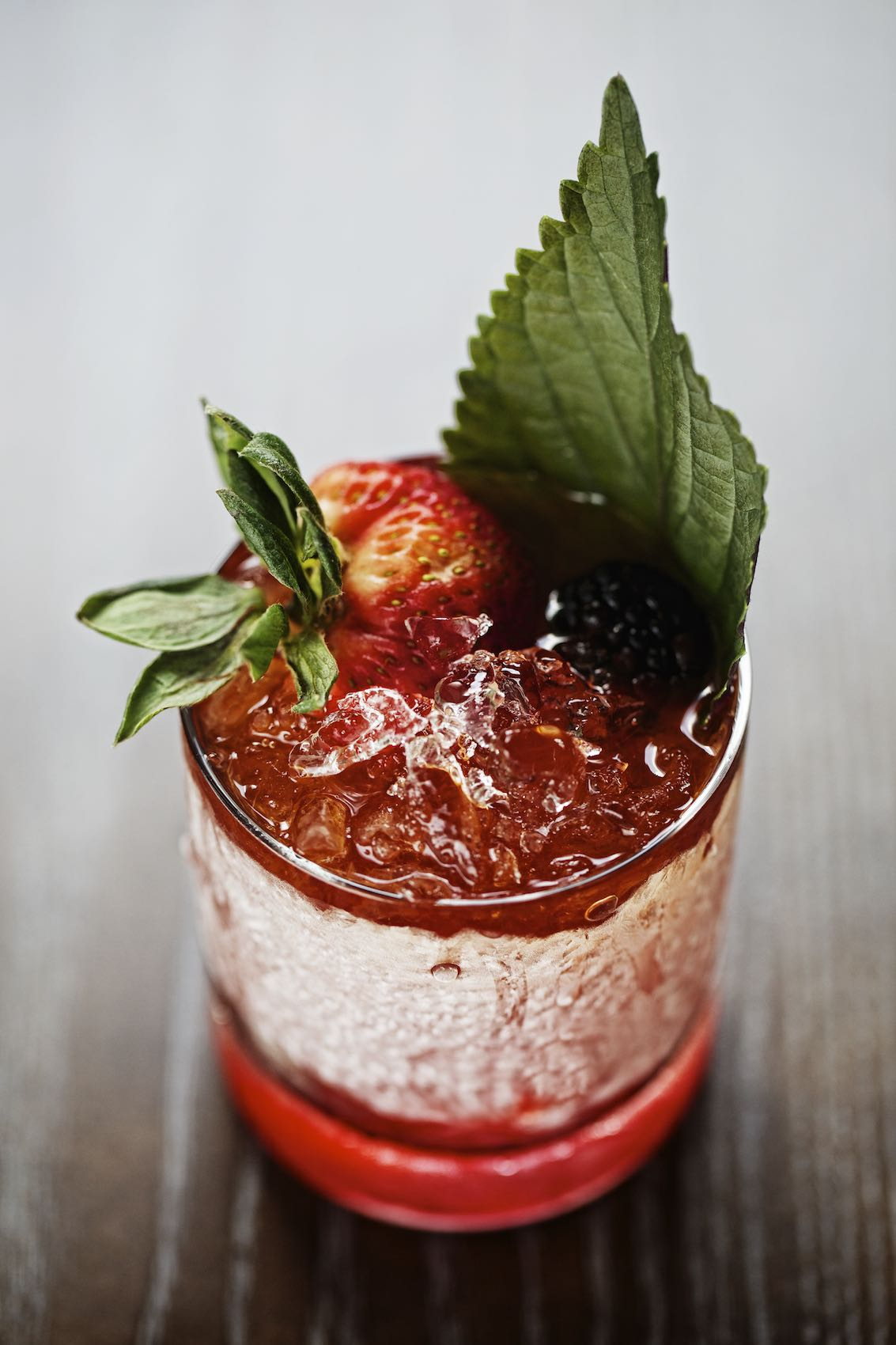 Jody Horton Photography - Frosty cocktail with berry and mint garnish.