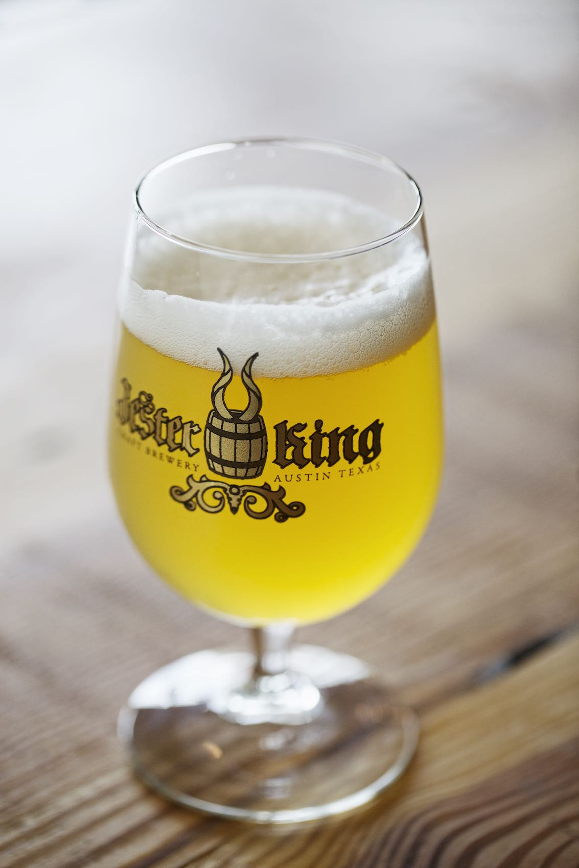 Jody Horton Photography - Jester King beer in a labeled stem glass.