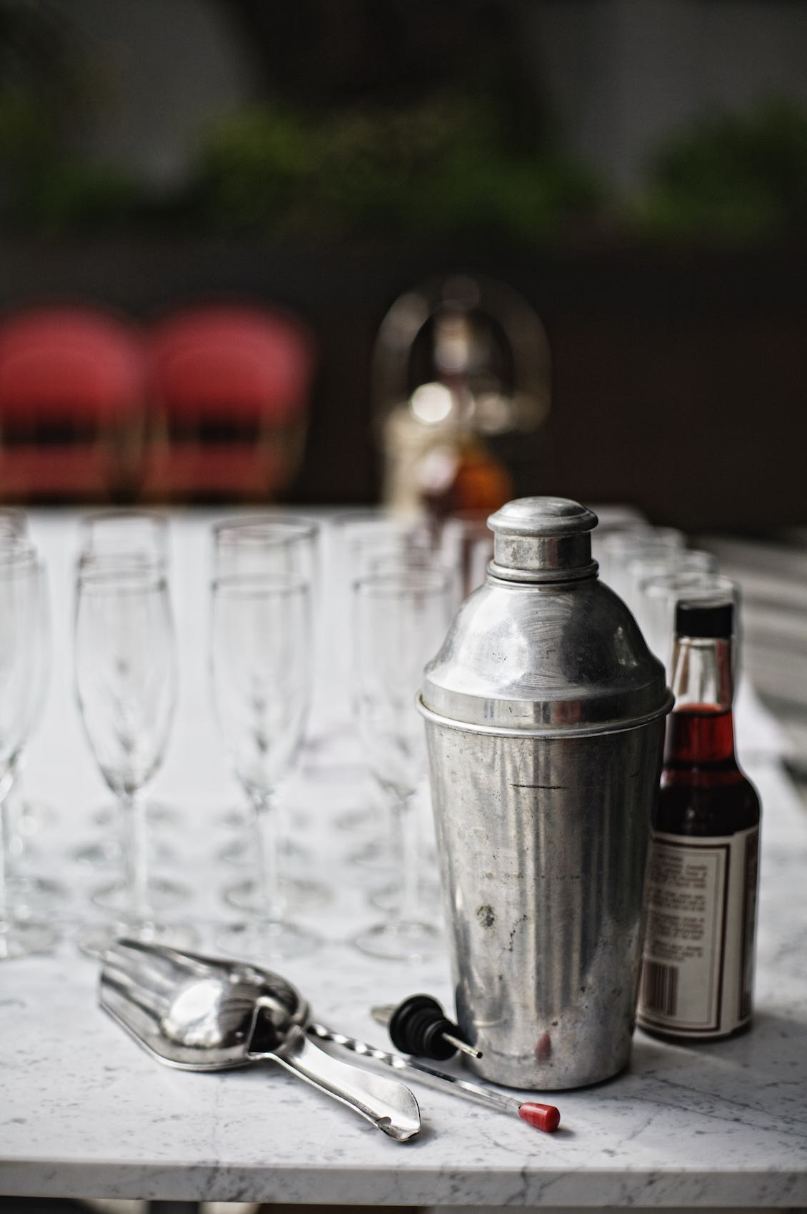 Jody Horton Photography - Vintage shaker, bitters and bar tools on granite table.