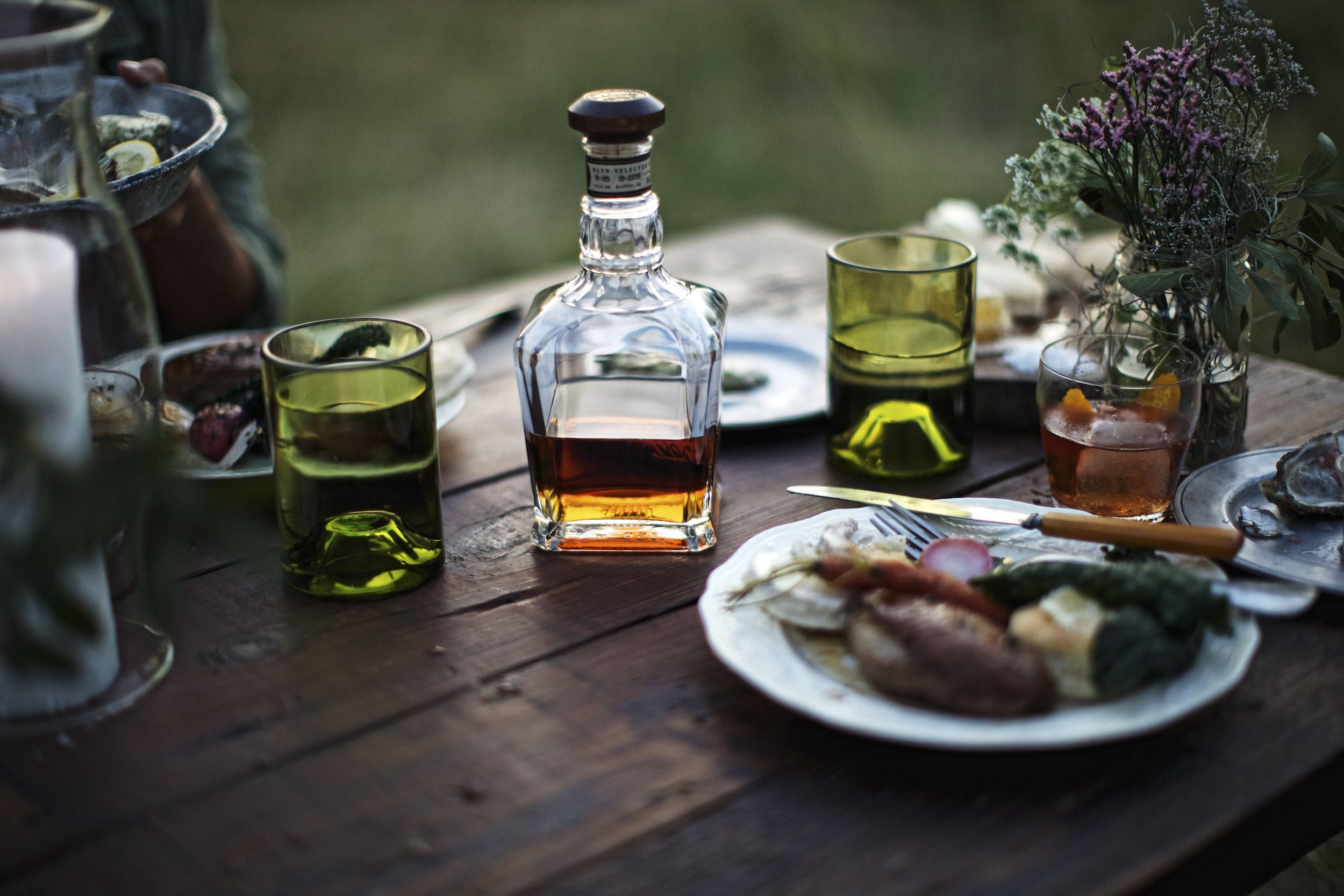 Jody Horton Photography - Jack Daniels Single Barrel bottle on outdoor dinner table.