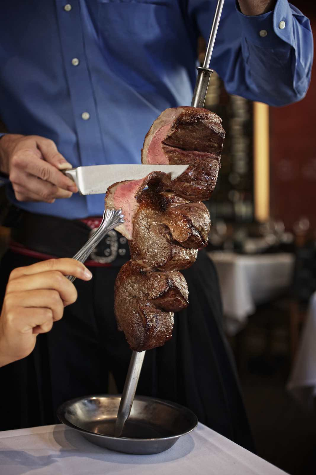 Jody Horton Photography - Fogo de Chao Restaurant meat cutting scene