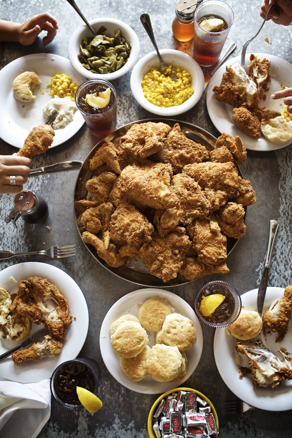 Jody Horton Photography - Fried chicken spread with Southern-style accompaniments.