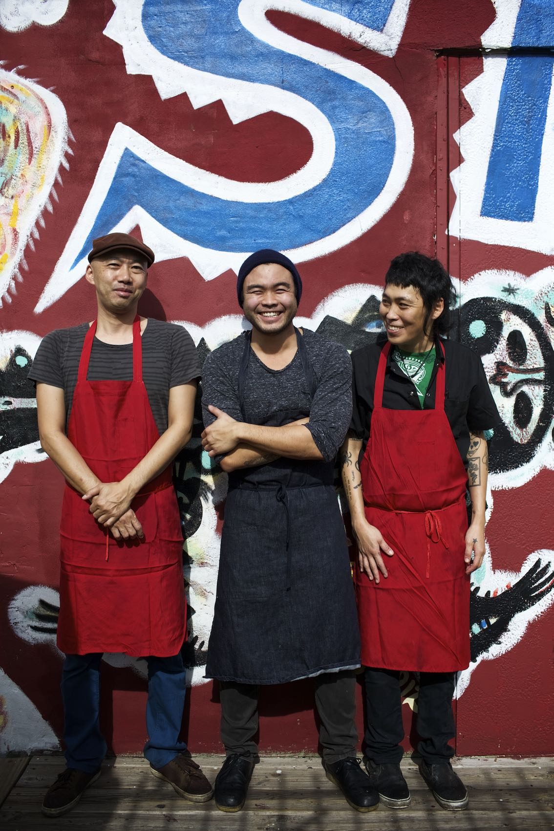 Jody Horton Photography - Three chefs standing against colorfully painted wall.