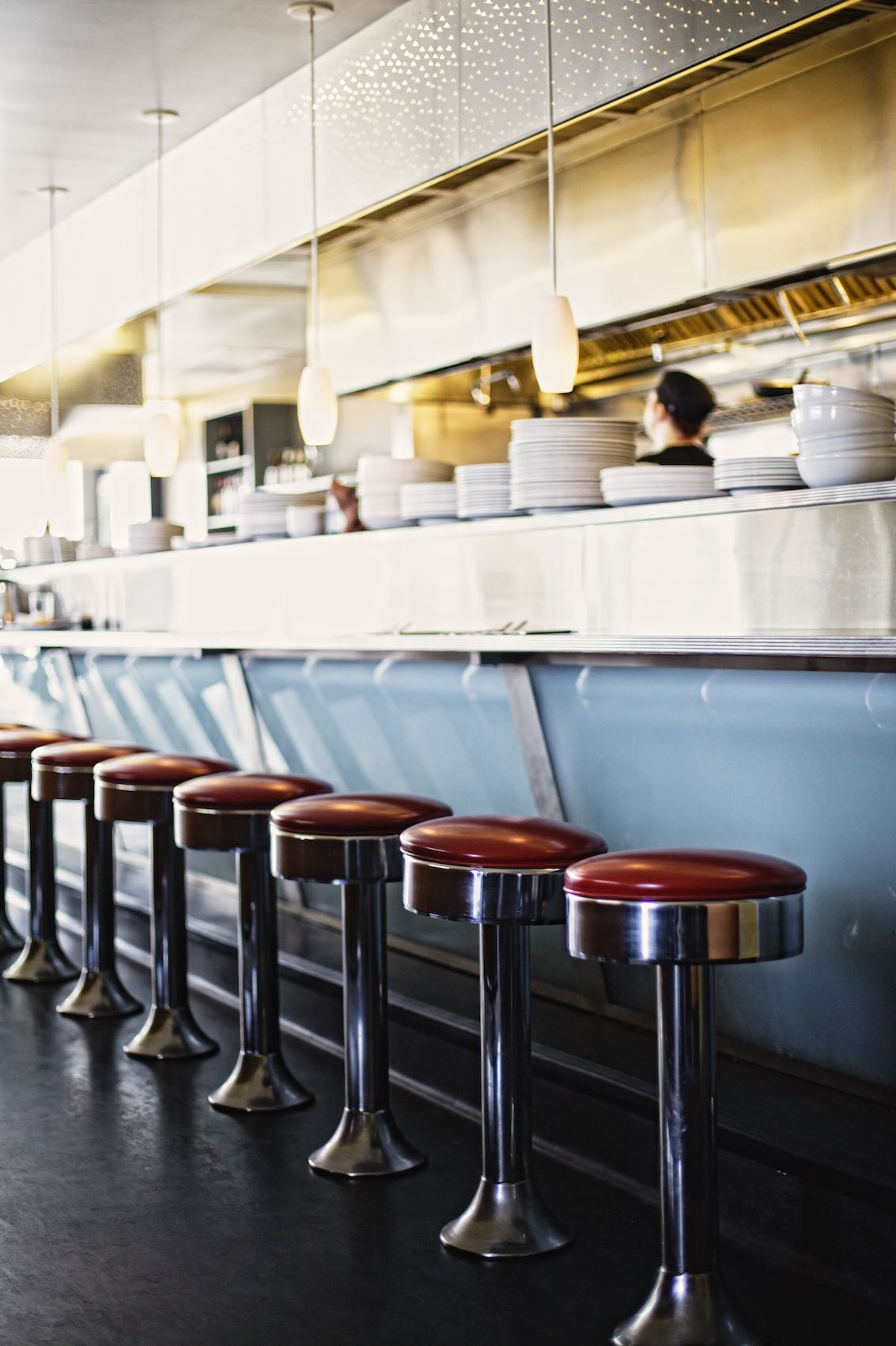 Jody Horton Photography - Brightly lit, diner bar with red stools and blue accents.