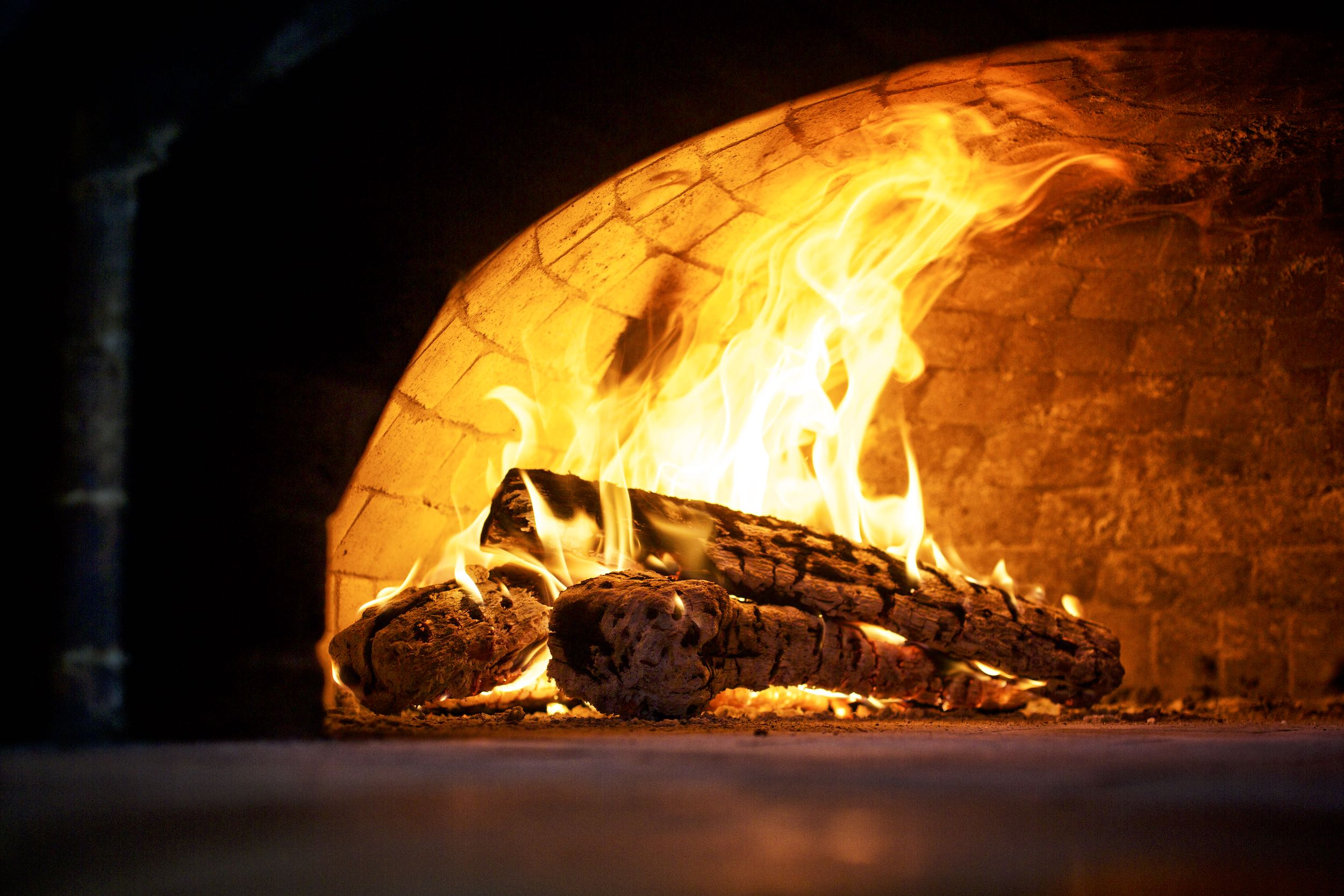 Jody Horton Photography - Wood fire in brick dome oven.