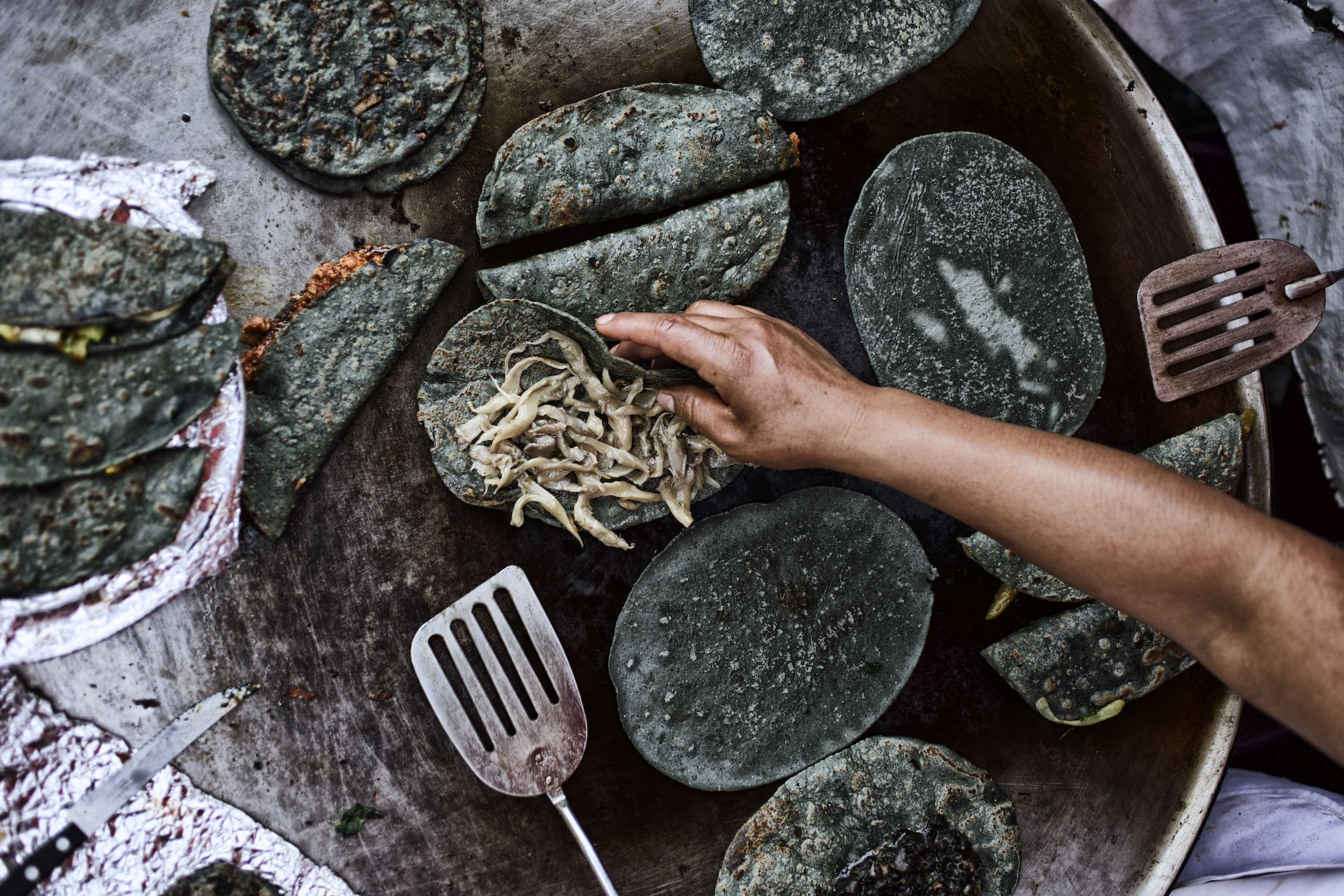 Jody Horton Photography - Cooking blue corn tortillas on flattop.
