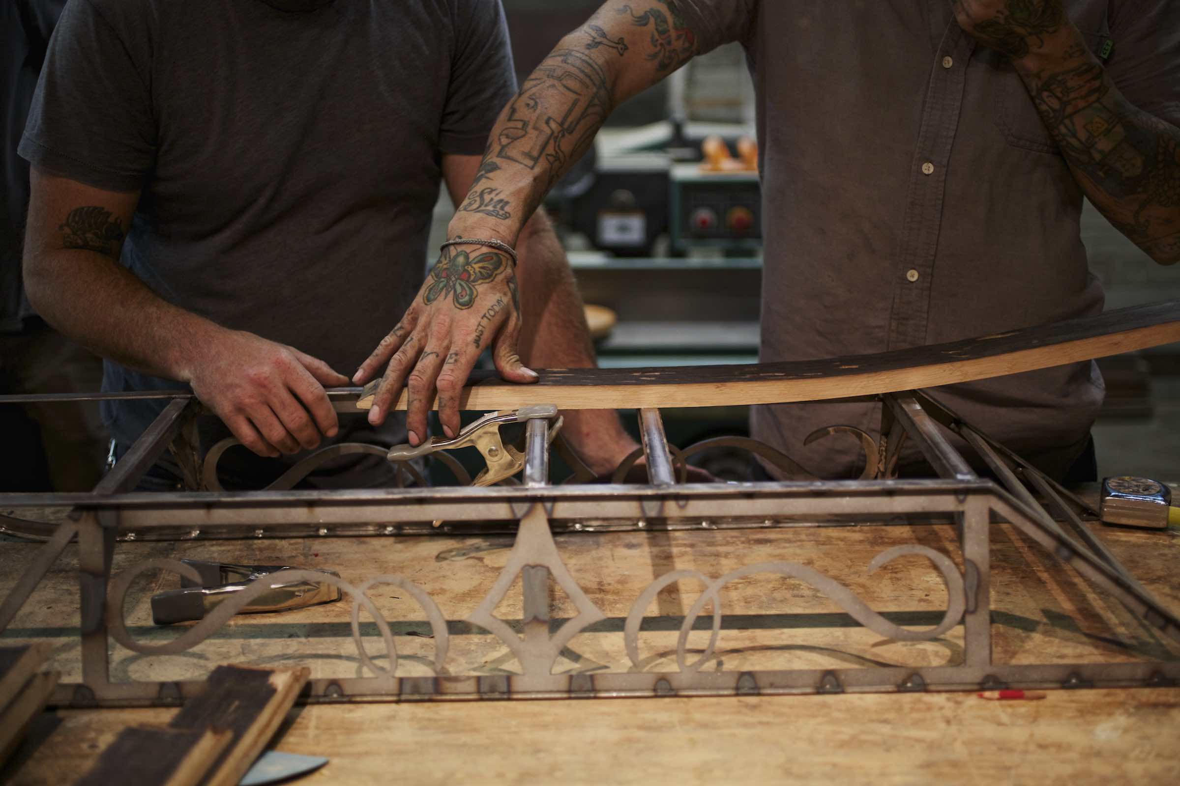 Jody Horton Photography - Men working together to manufacture sled.