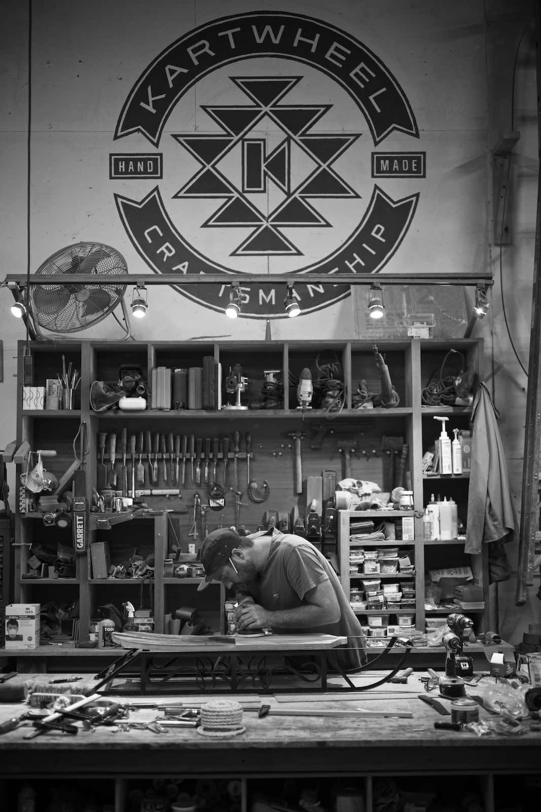 Jody Horton Photography - Carpenter sanding down sled, shot in B&W.