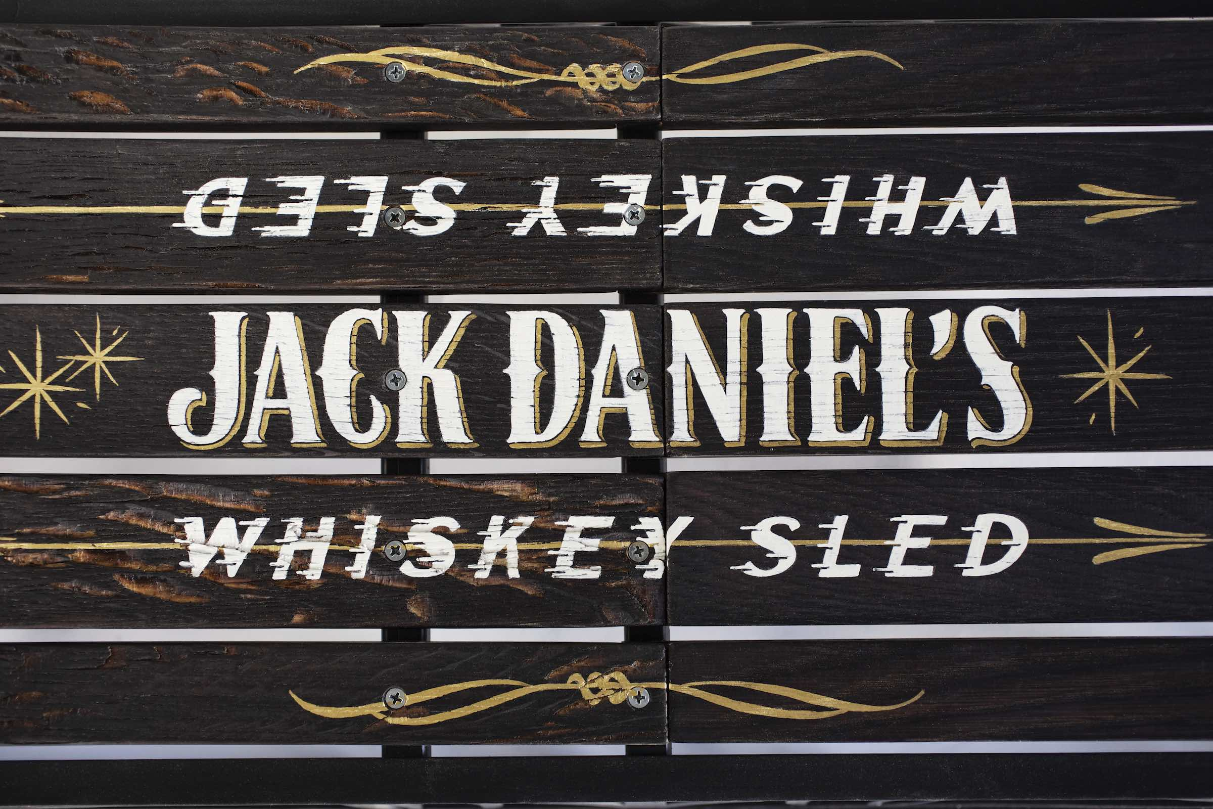 Jody Horton Photography - Wood panels painted with gold and white lettering for Jack Daniel