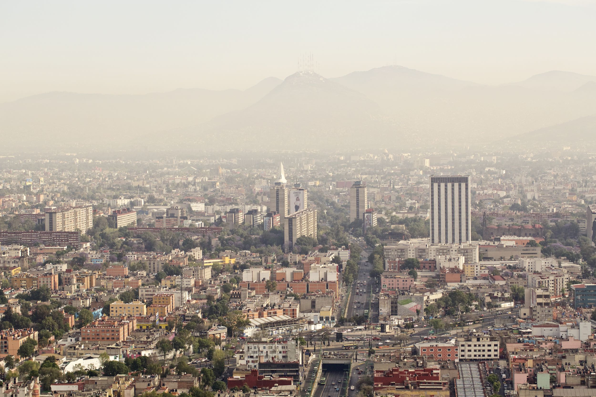 Jody Horton Photography - Overview of Mexico City set in front of a range of mountains.