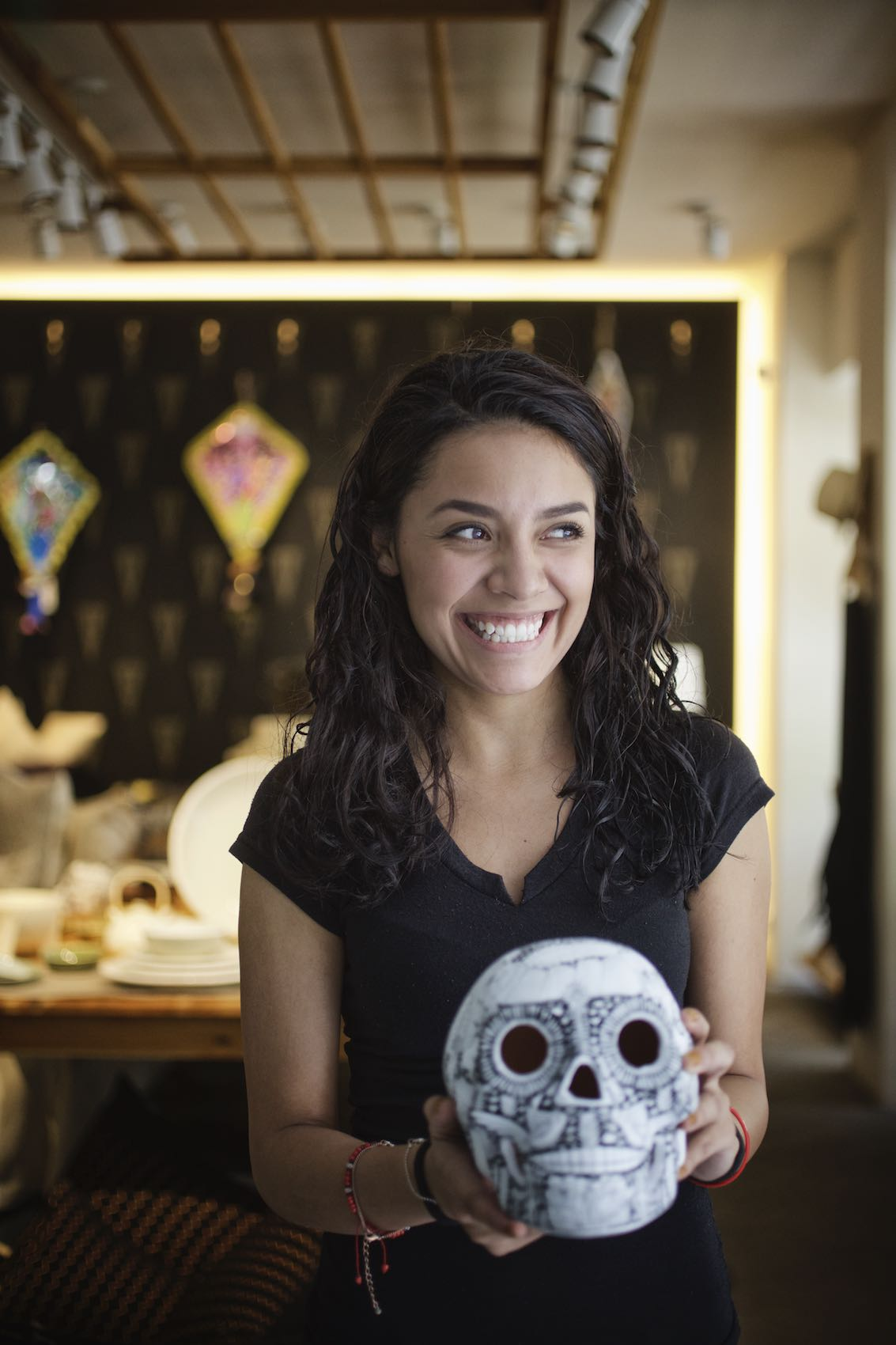 Jody Horton Photography - Young woman smiling and holding a  decorative skull.
