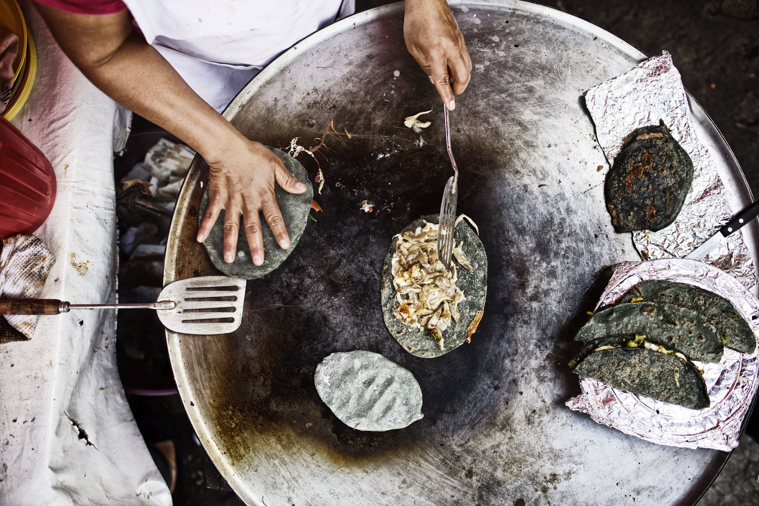 Jody Horton Photography - Tacos being prepared on a plancha.