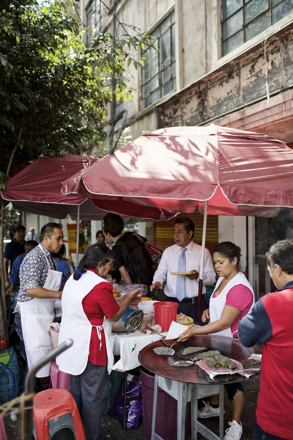 Jody Horton Photography - Street vendors cooking and selling food in Mexico City.