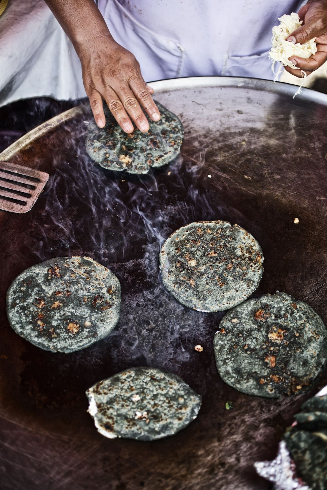 Jody Horton Photography - Blue corn tortillas cooking on a plancha.