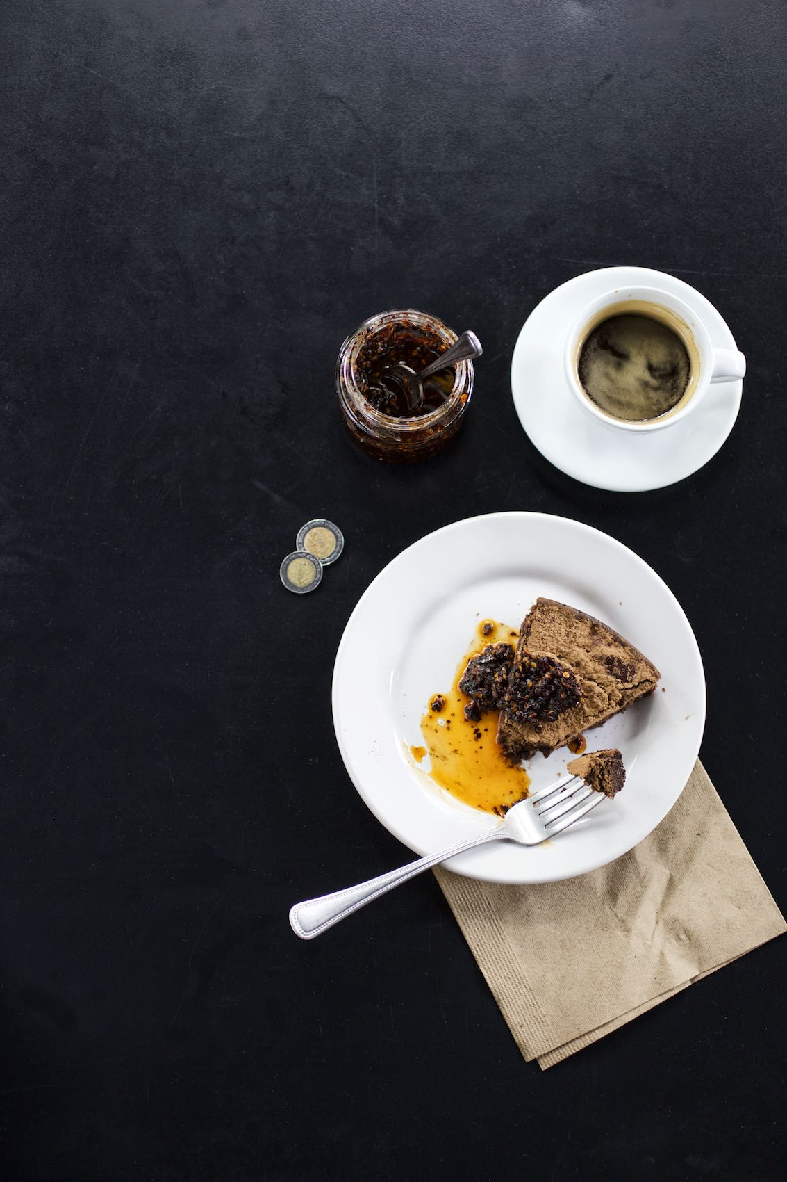 Jody Horton Photography - Cafe snack, espresso, and pesos on a black table.