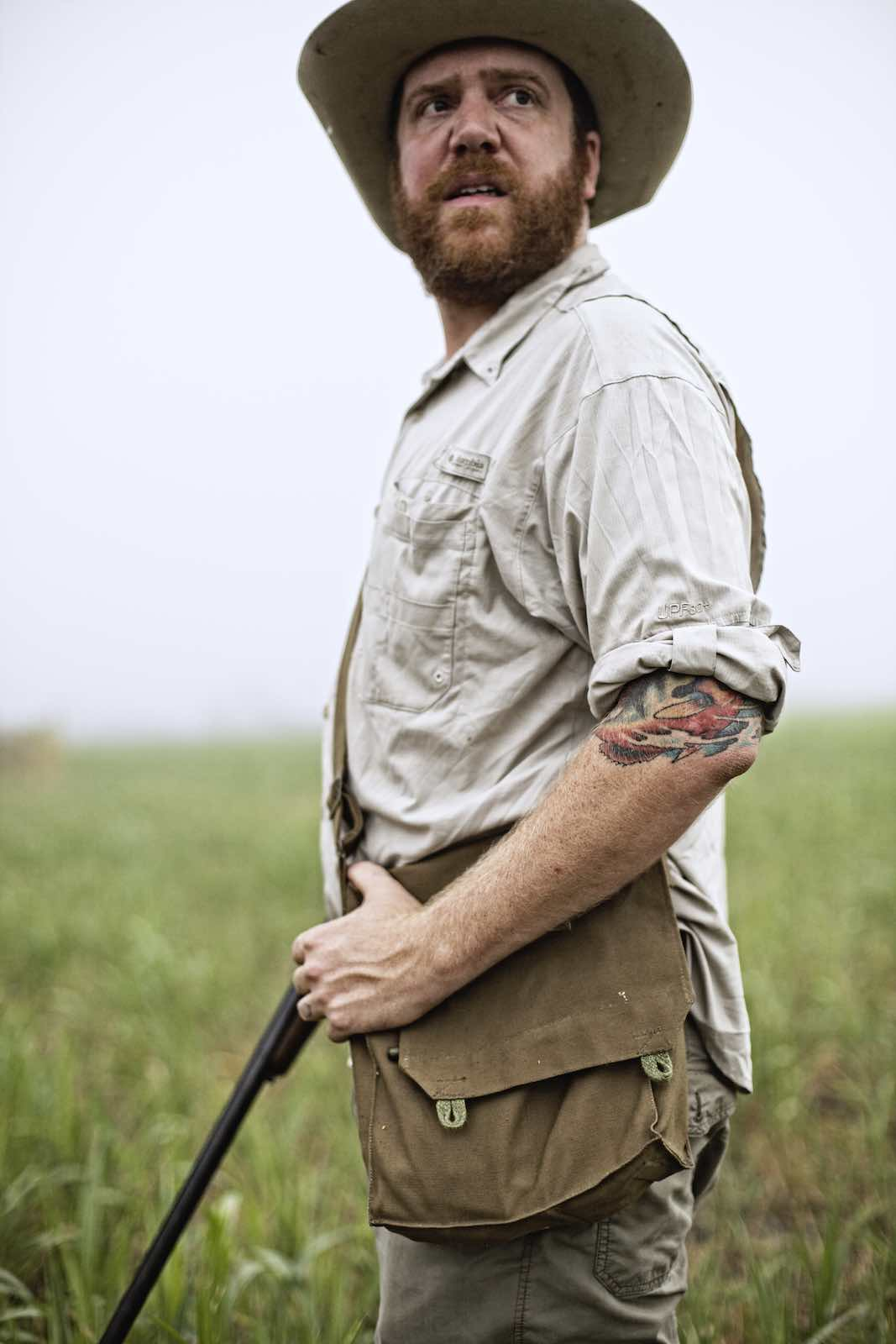 Jody Horton Photography - Chef Jesse standing with his rifle.