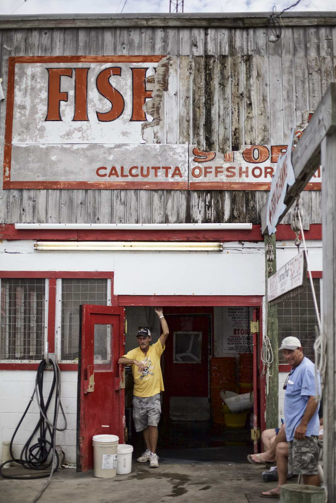 Jody Horton Photography - Fishermen standing outside store.