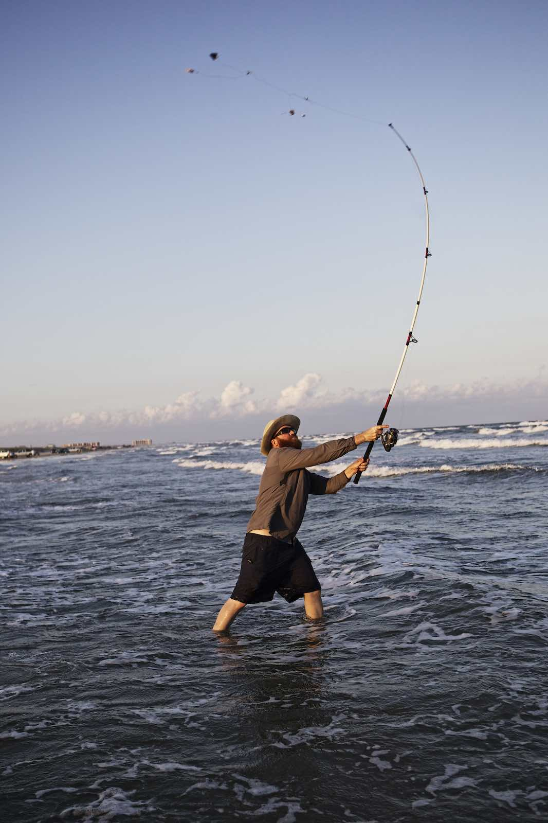 Jody Horton Photography - Chef Jesse casting a fishing line on the beach.