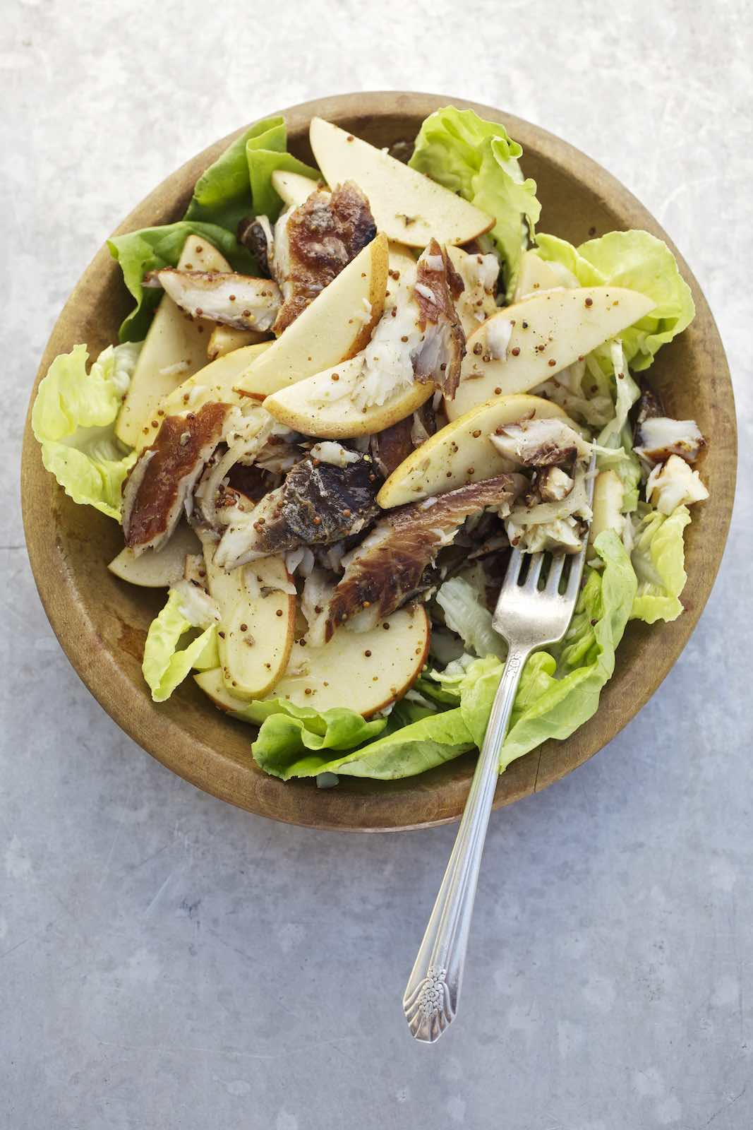 Jody Horton Photography - Salad topped with sliced pear and grilled fish.