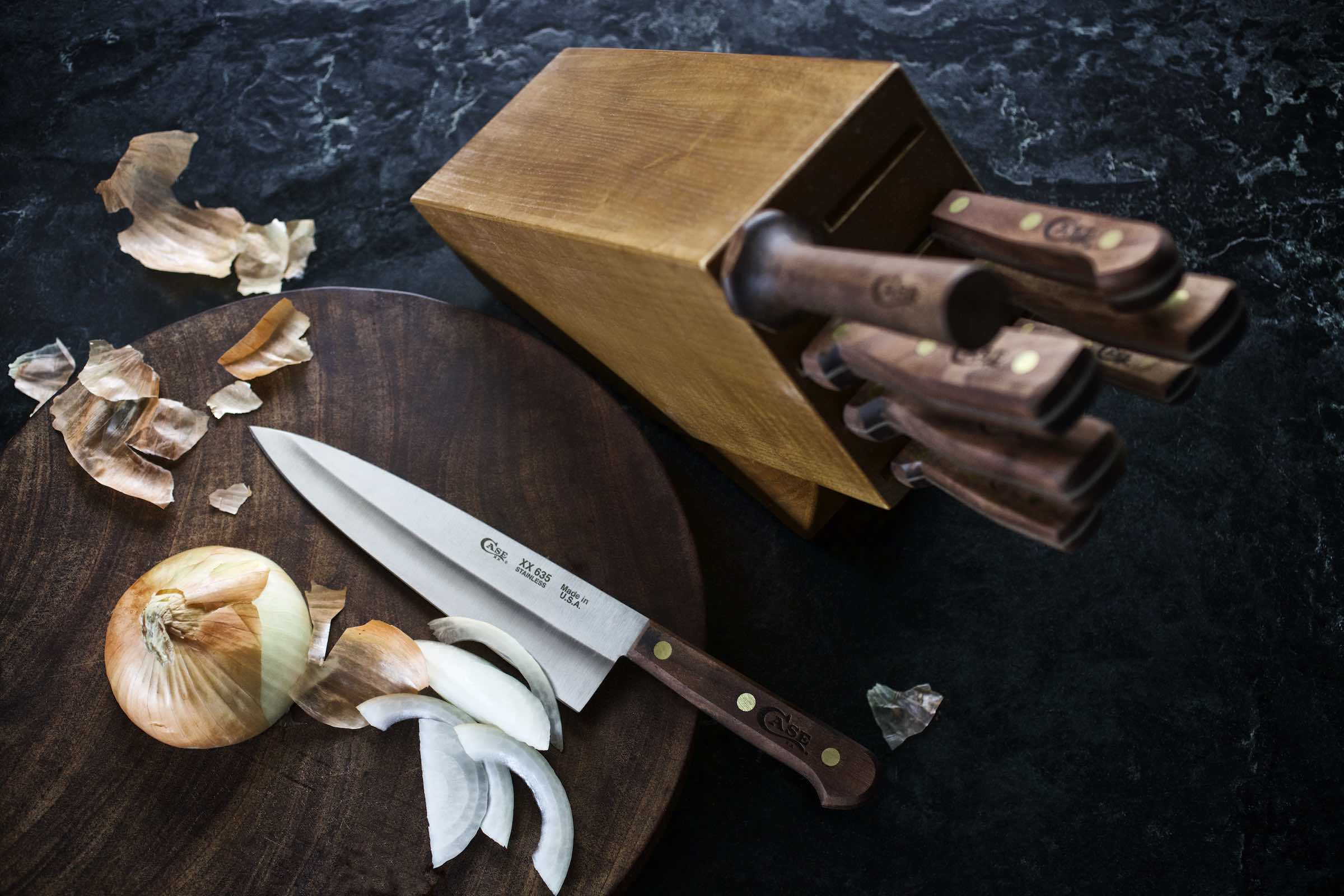 Jody Horton Photography - Case chef knife on wood cutting board with sliced onion.