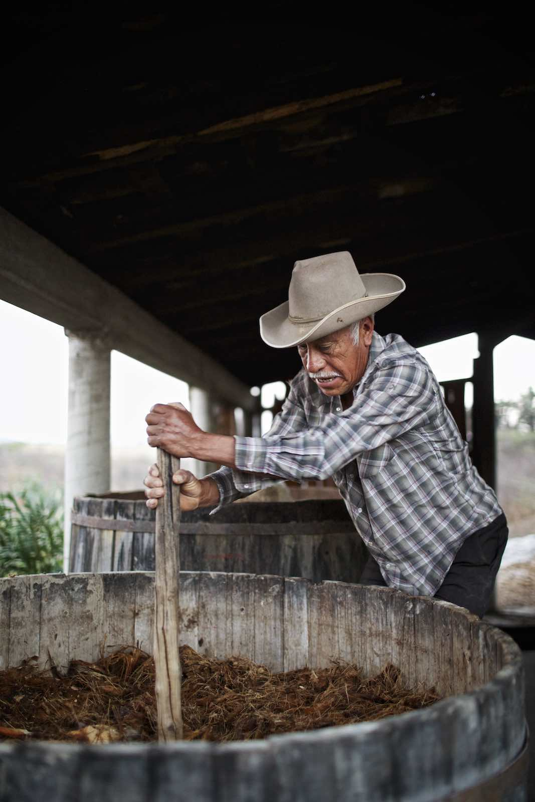 Jody Horton Photography - Farmer mixing agave fibers.