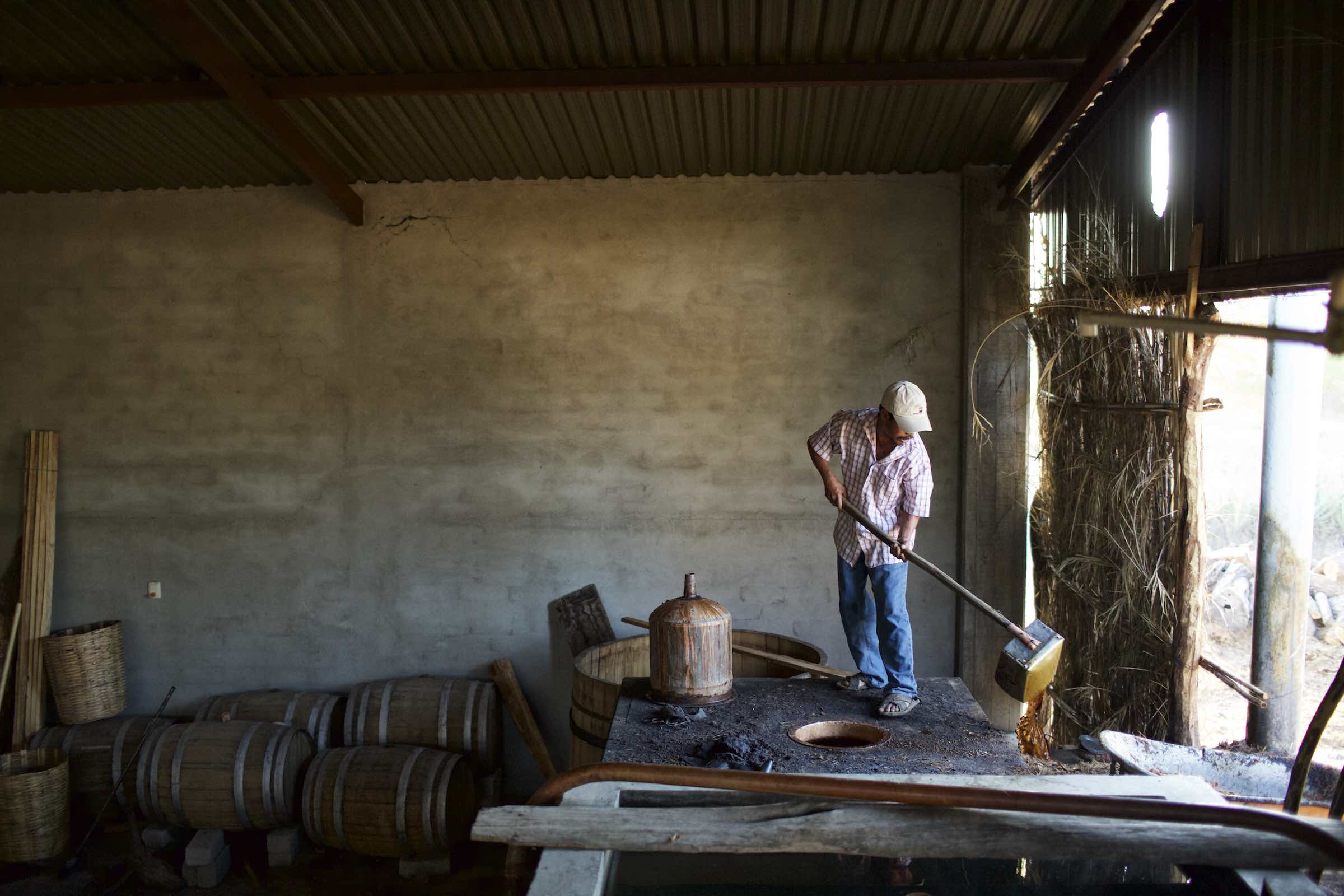 Jody Horton Photography - Farmer disposing of liquids during production.
