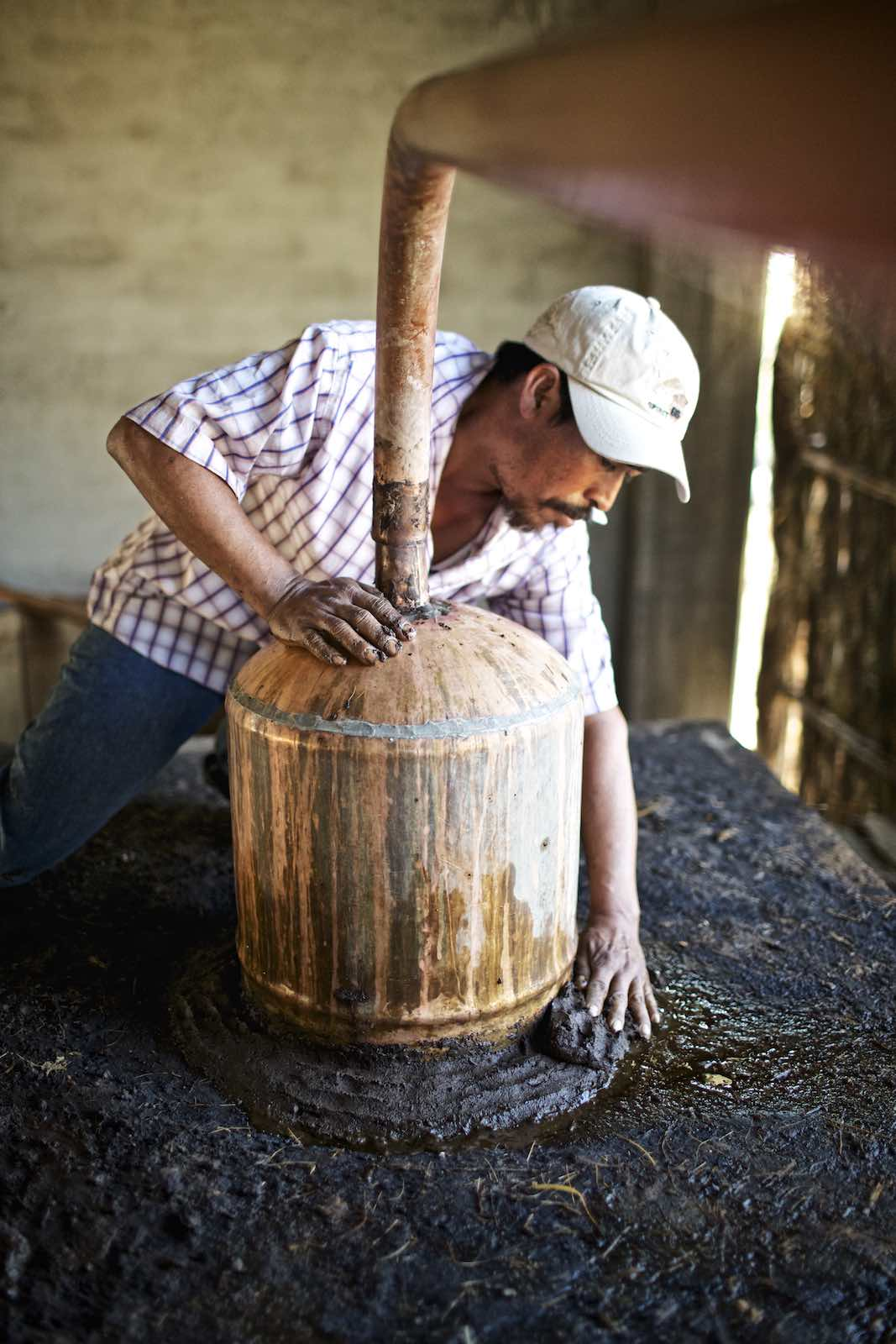 Jody Horton Photography - Worker securing vats with mud.