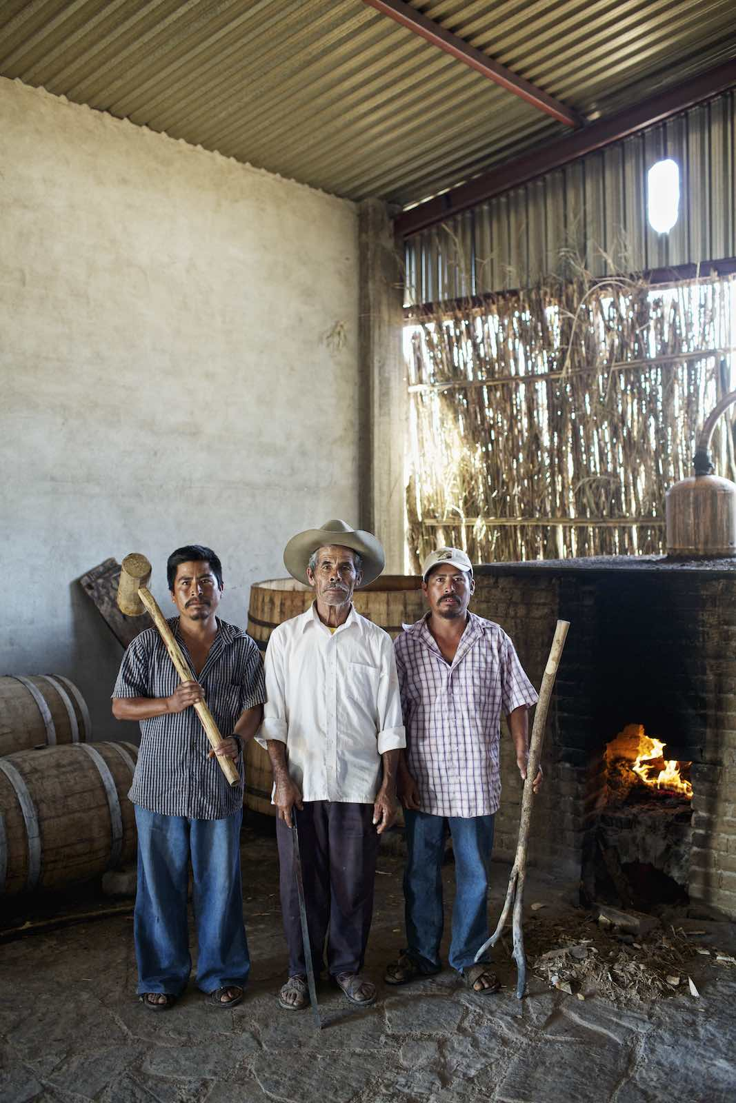 Jody Horton Photography - Mezcal workers standing together during production.