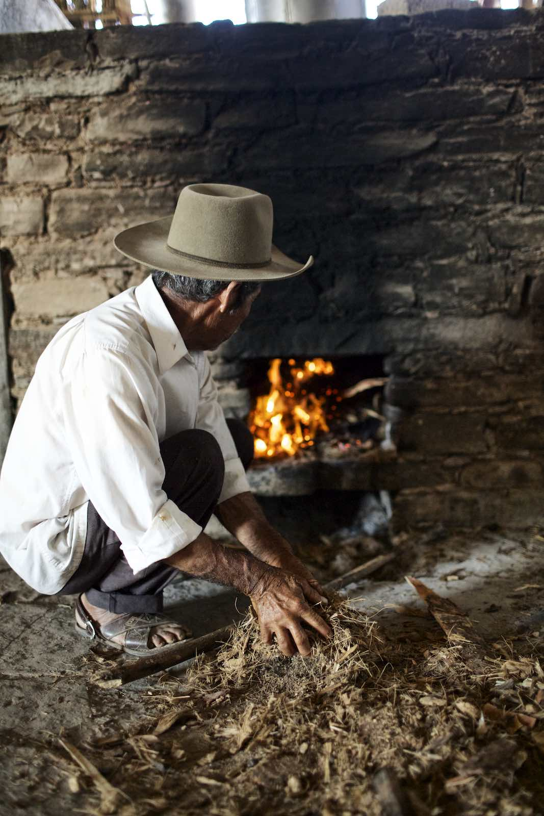 Jody Horton Photography - Farmer building a small fire.