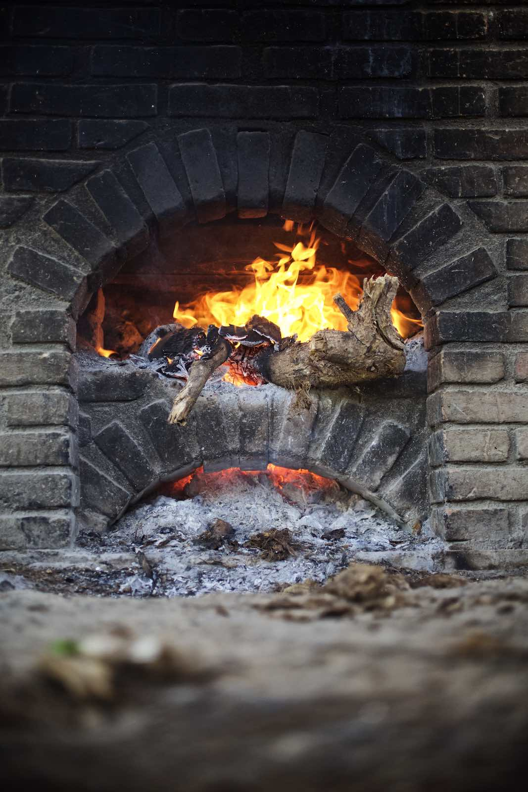 Jody Horton Photography - Wood fire during mezcal production.