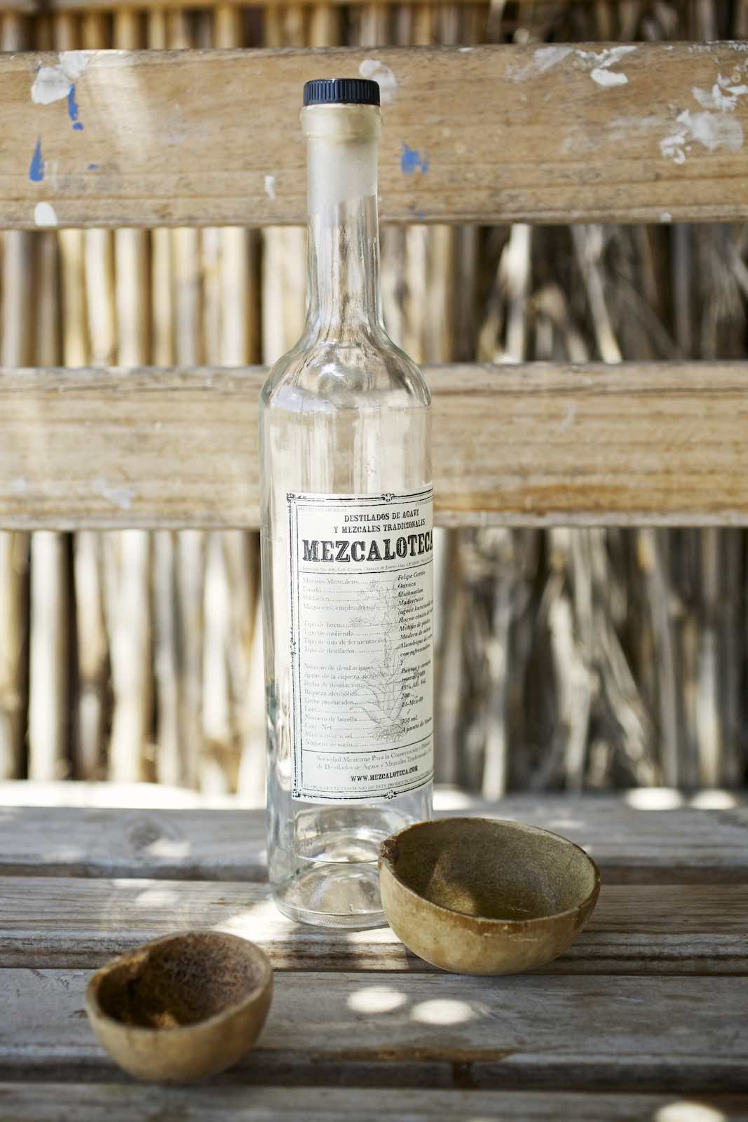 Jody Horton Photography - Bottled mezcal and jícaras.