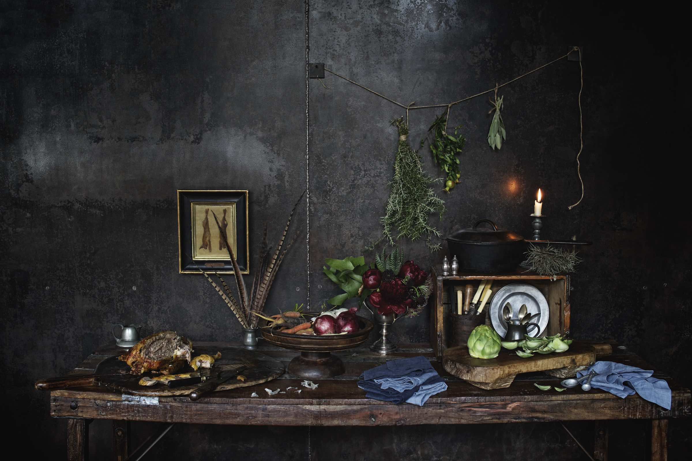 Jody Horton Photography - Rustic food preparation scene on a candlelit, wood table.