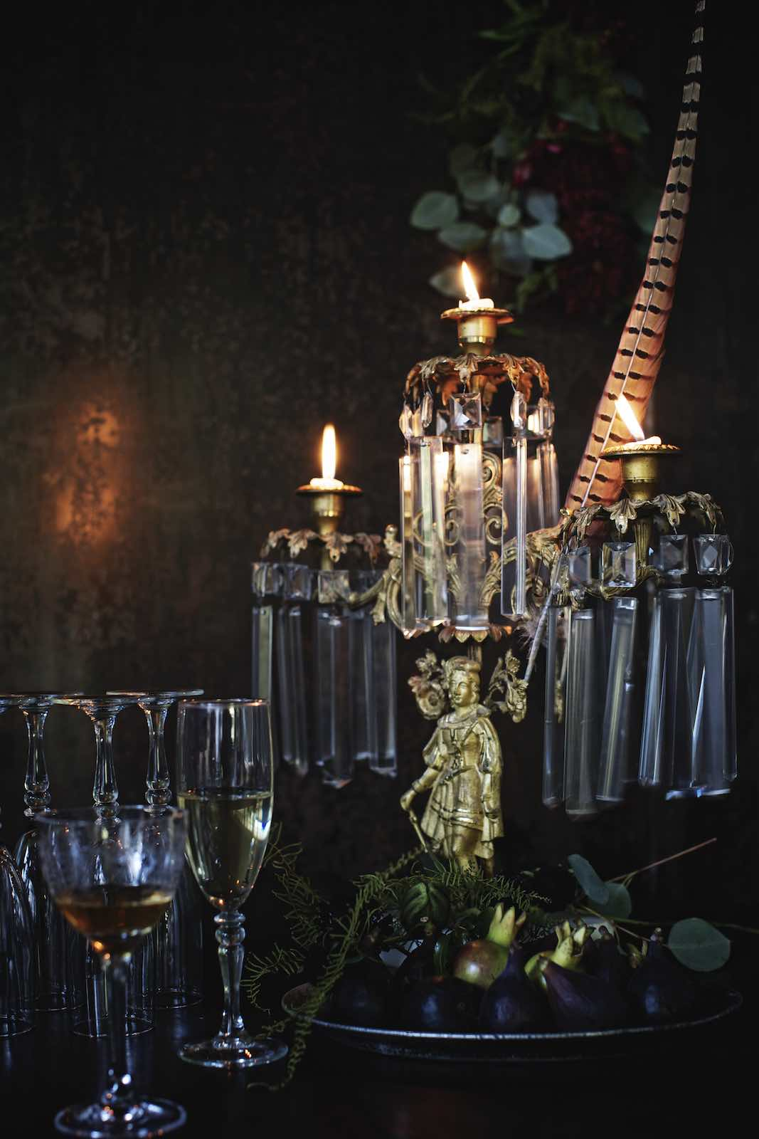 Jody Horton Photography - Regal candelabra illuminating crystal beverage glasses.