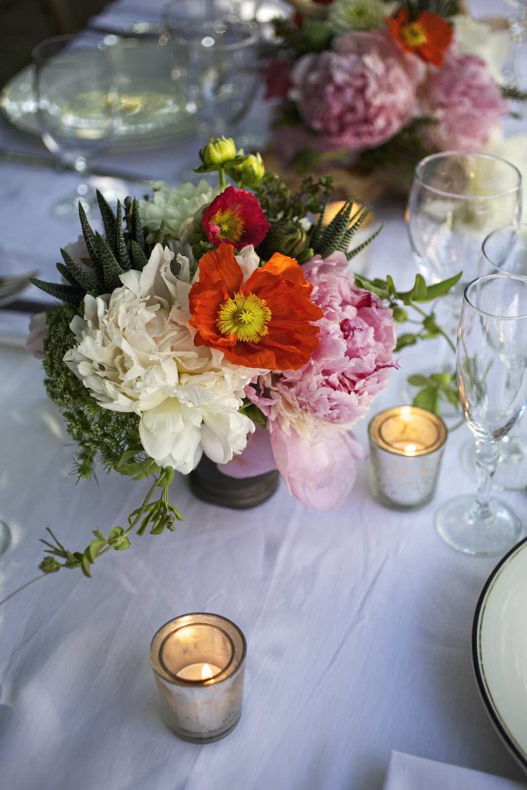 Jody Horton Photography - Vivid floral arrangement encircled by tea candles.