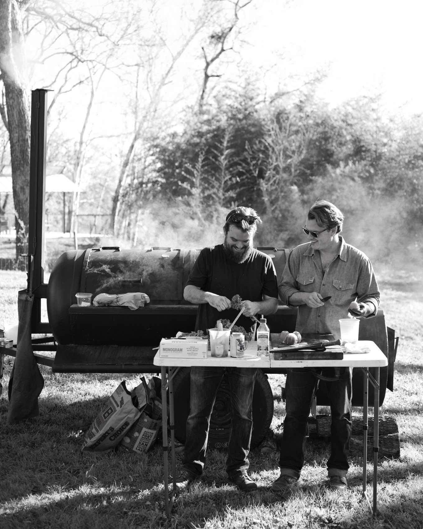 Jody Horton Photography - Chefs prepping ingredients in front of outdoor smoker, shot in B&W.
