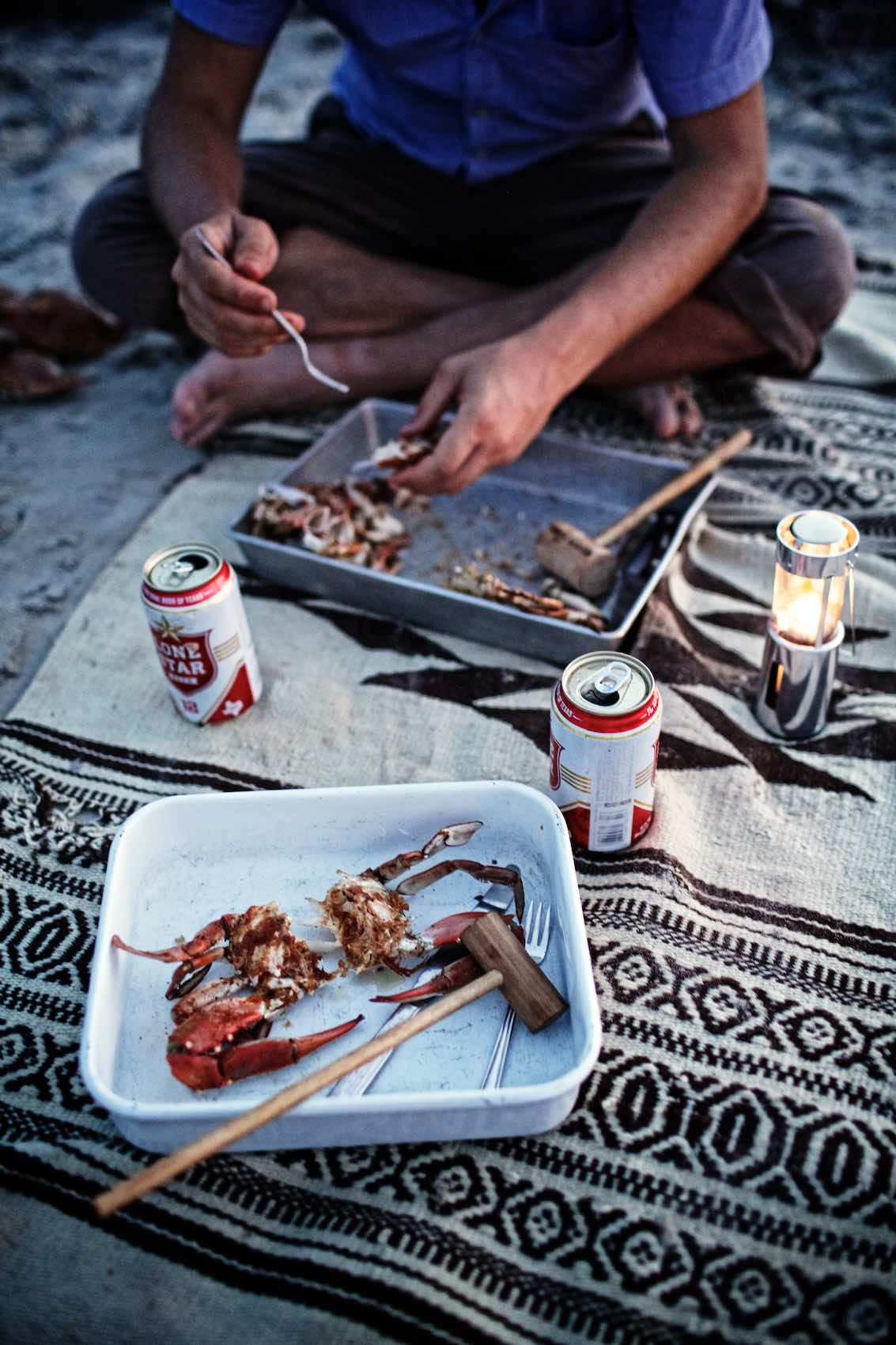 Jody Horton Photography - Grilled crab and canned Lonestar Beers on a beach blanket.